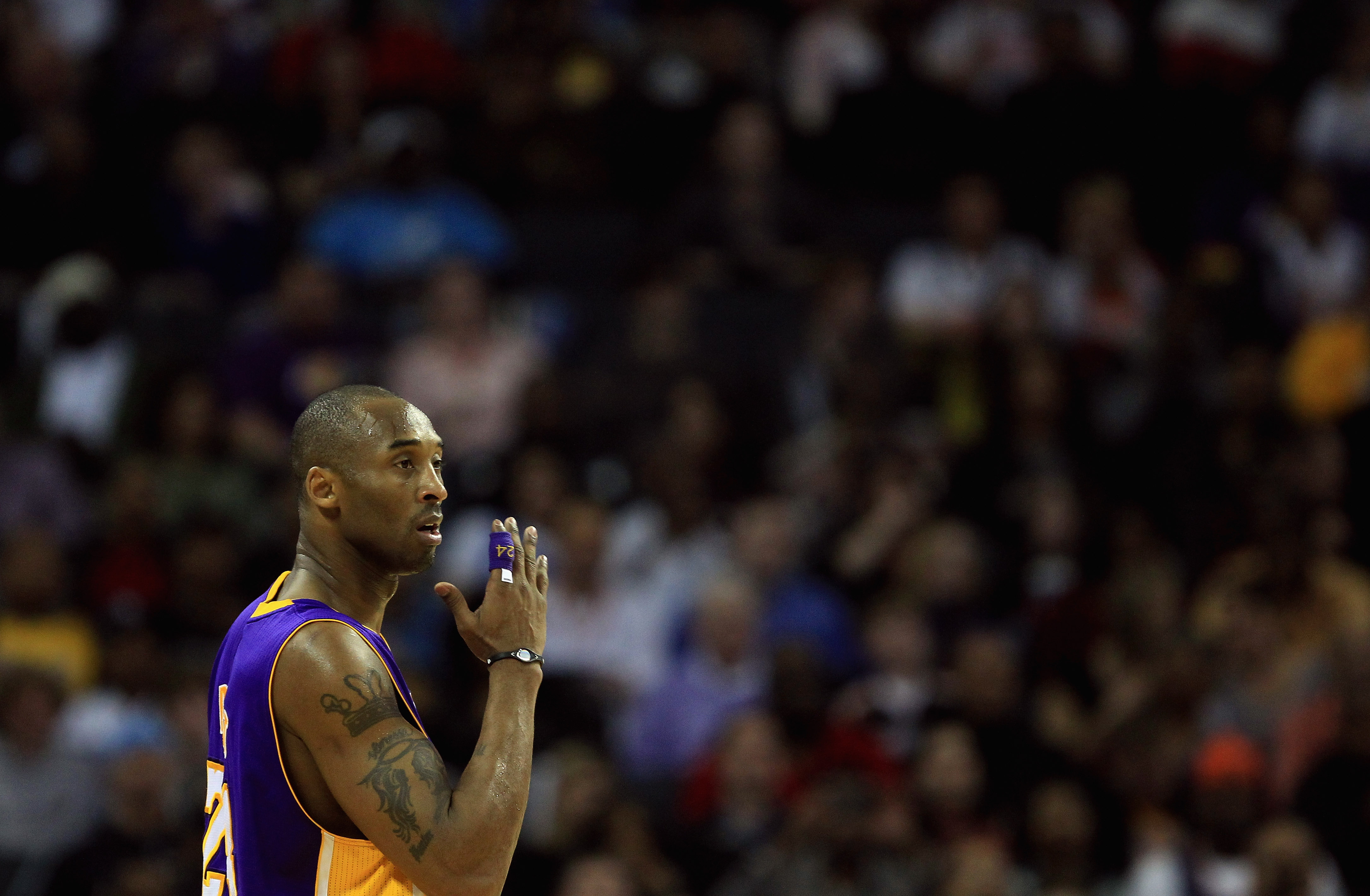 CHARLOTTE, NC - FEBRUARY 14:  Kobe Bryant #24 of the Los Angeles Lakers reacts to his bench against the Charlotte Bobcats during their game at Time Warner Cable Arena on February 14, 2011 in Charlotte, North Carolina. NOTE TO USER: User expressly acknowle