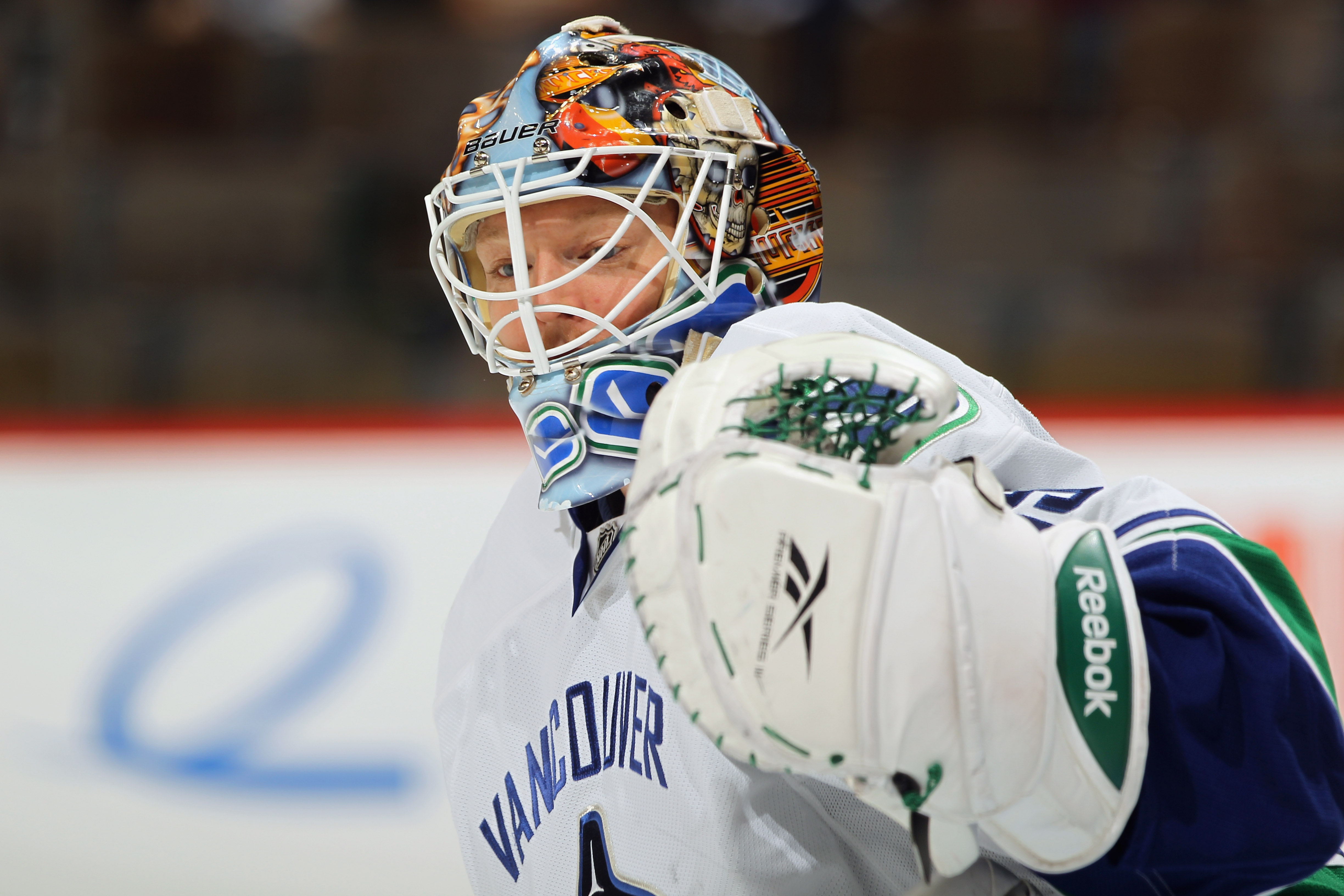 DENVER, CO - JANUARY 18:  Goalie Cory Schneider #35 of the Canucks looks on during warm up prior to facing the Colorado Avalanche at the Pepsi Center on January 18, 2011 in Denver, Colorado. The Avalanche defeated the Canucks 4-3 in overtime.  (Photo by D