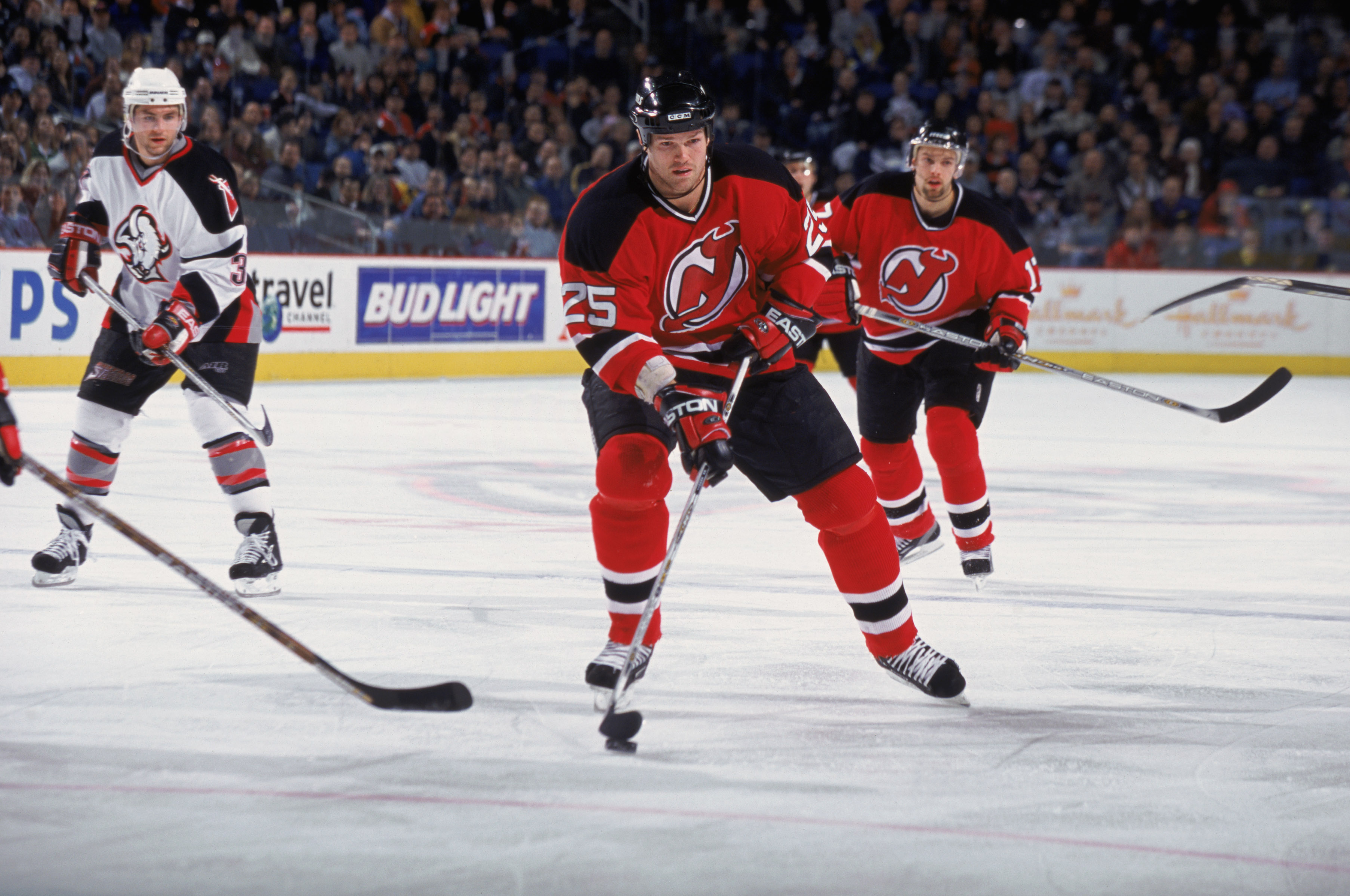 12 Feb 2002:  Jason Arnot #25 of the New Jersey Devils and teammate, right wing Petr Sykora #17, skate on the ice during the NHL game against the Buffalo Sabres at the HSBC Arena in Buffalo, New York. The Devils tied the Sabres, 2-2.   \ Mandatory Copyrig