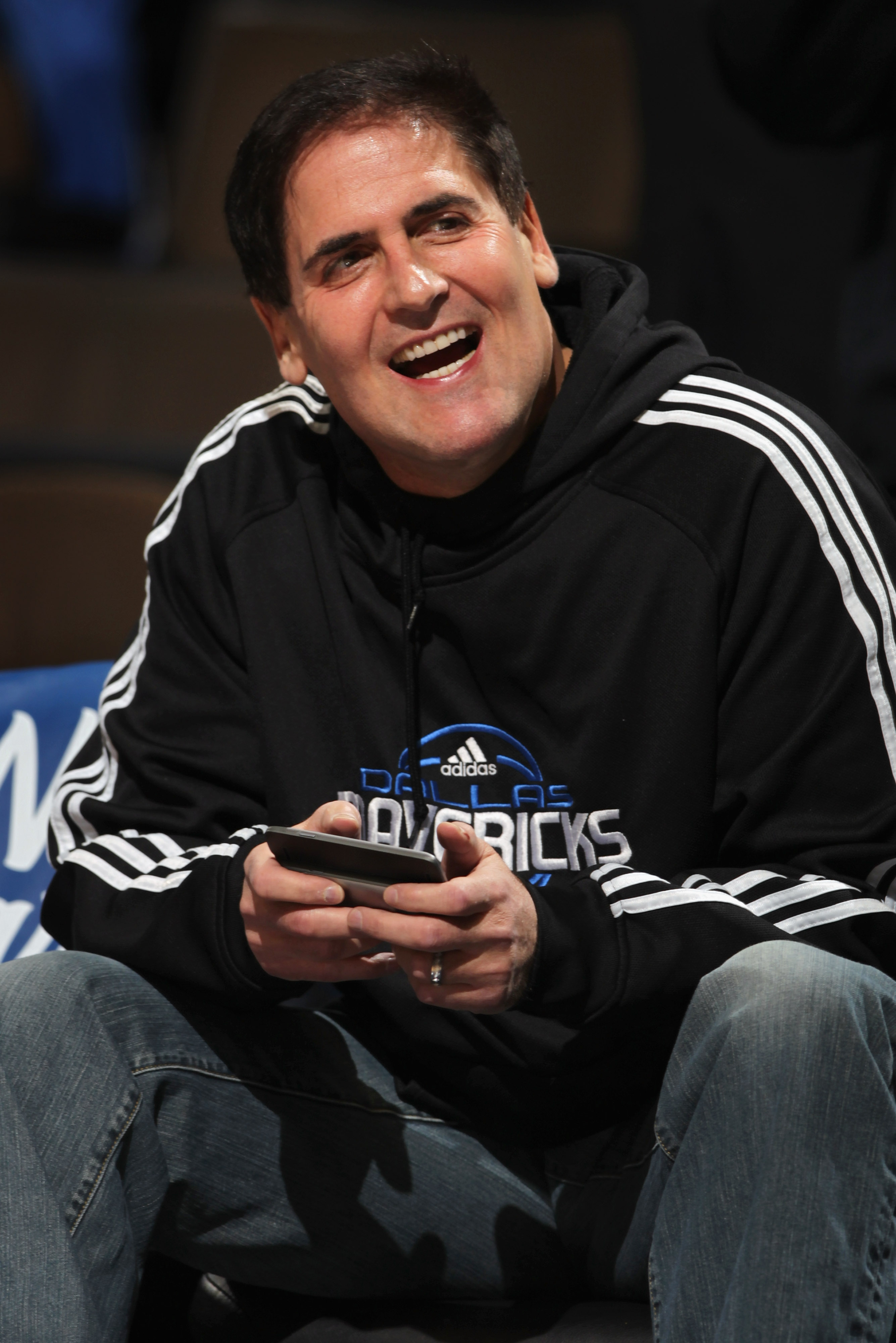 DENVER, CO - FEBRUARY 10:  Mark Cuban, owner of the Dallas Mavericks, uses a personal electonic device as he sits on the bench during warm ups against the Denver Nuggets during NBA action at the Pepsi Center on February 10, 2011 in Denver, Colorado. The N