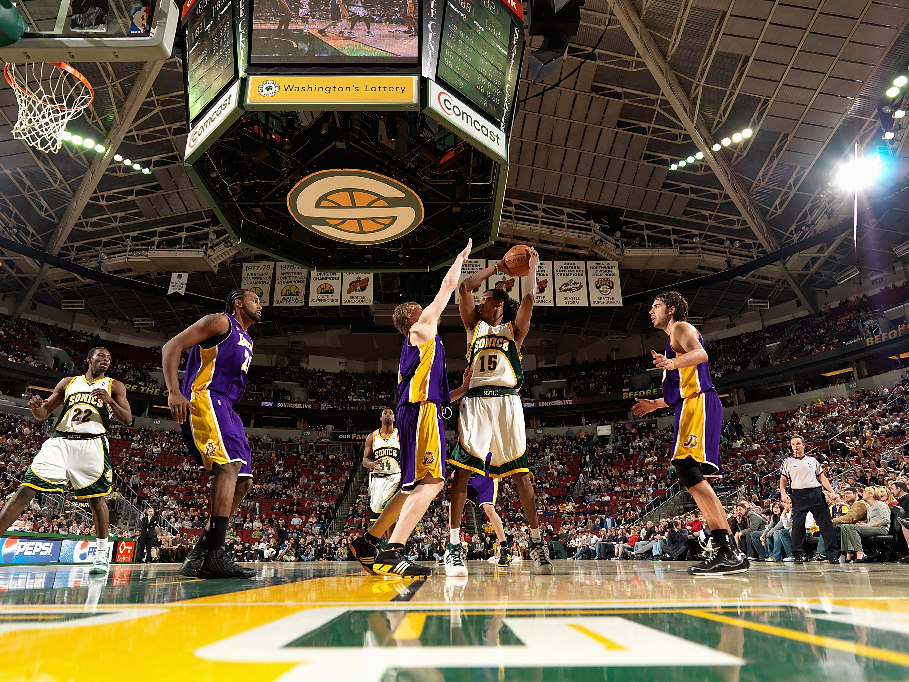 SEATTLE - FEBRUARY 24:  Mickael Gelabale #15 of the Seattle SuperSonics looks to pass over Coby Karl #11 of the Los Angeles Lakers during the game on February 24, 2008 at Key Arena in Seattle, Washington.  The Lakers won 111-91.  NOTE TO USER: User expres