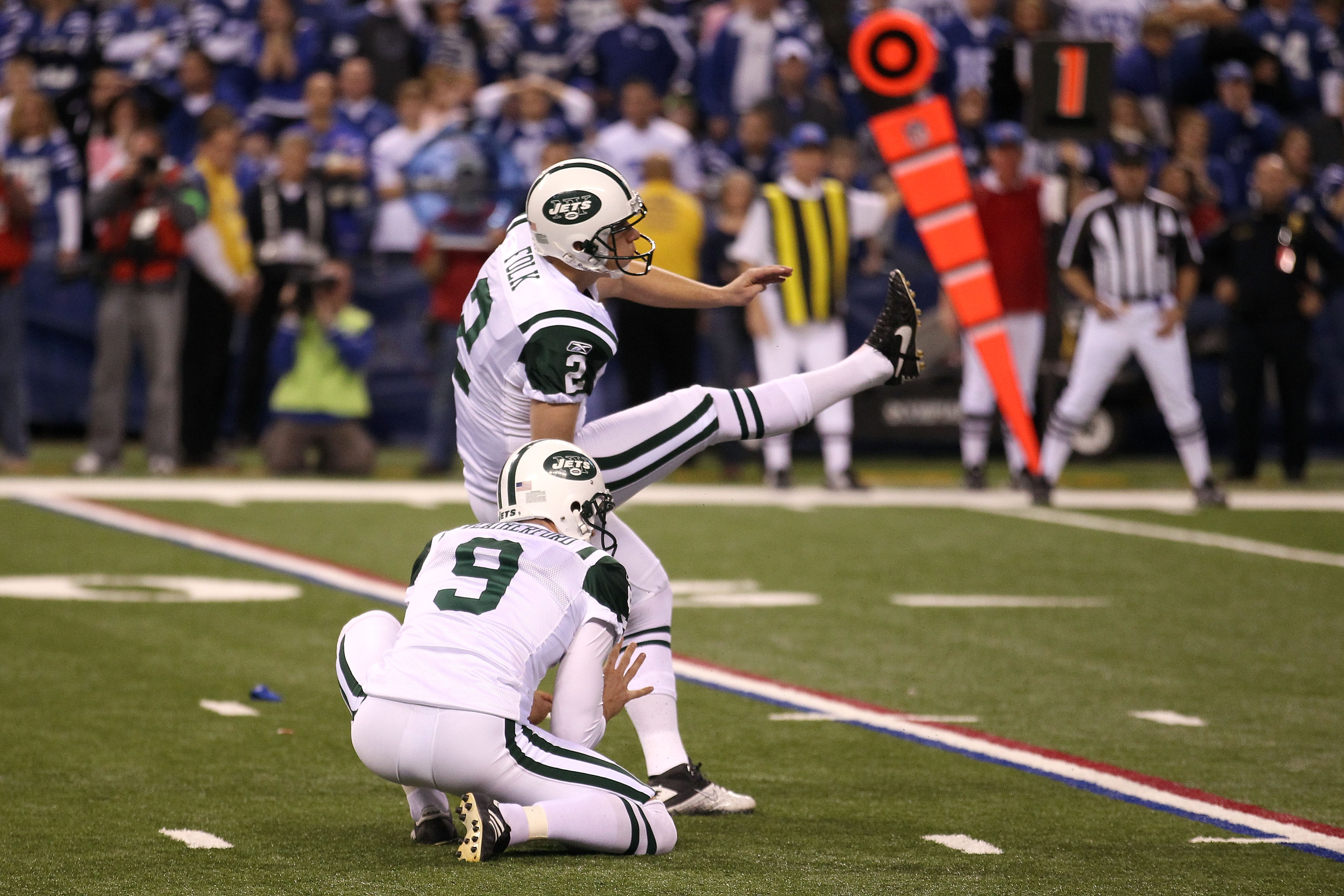 INDIANAPOLIS, IN - JANUARY 08:  Place kicker Nick Folk #2 of the New York Jets successfully kicks a game-winning a 32-yard field goal in the fourth quarter to win 17-16 against the Indianapolis Colts during their 2011 AFC wild card playoff game at Lucas O