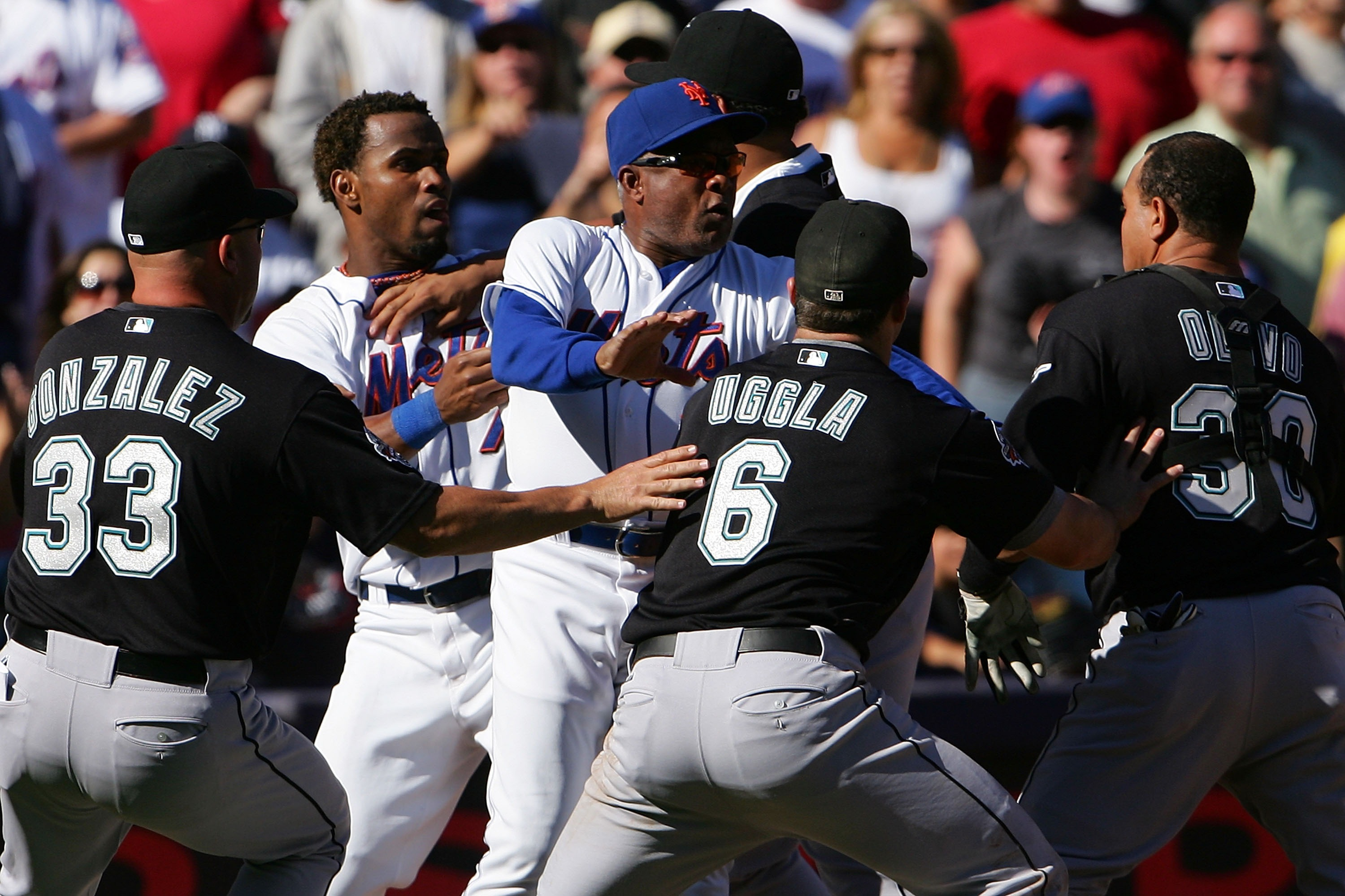 NEW YORK - SEPTEMBER 29:  Miguel Cabrera #24 of the Florida Marlins holds back Jose Reyes #7 of the New York Mets as New York Mets third base coach Sandy Alomar #28 holds back Marlins players Fredi Gonzalez #33, Dan Uggla #6 and Miguel Olivo #30 after a f