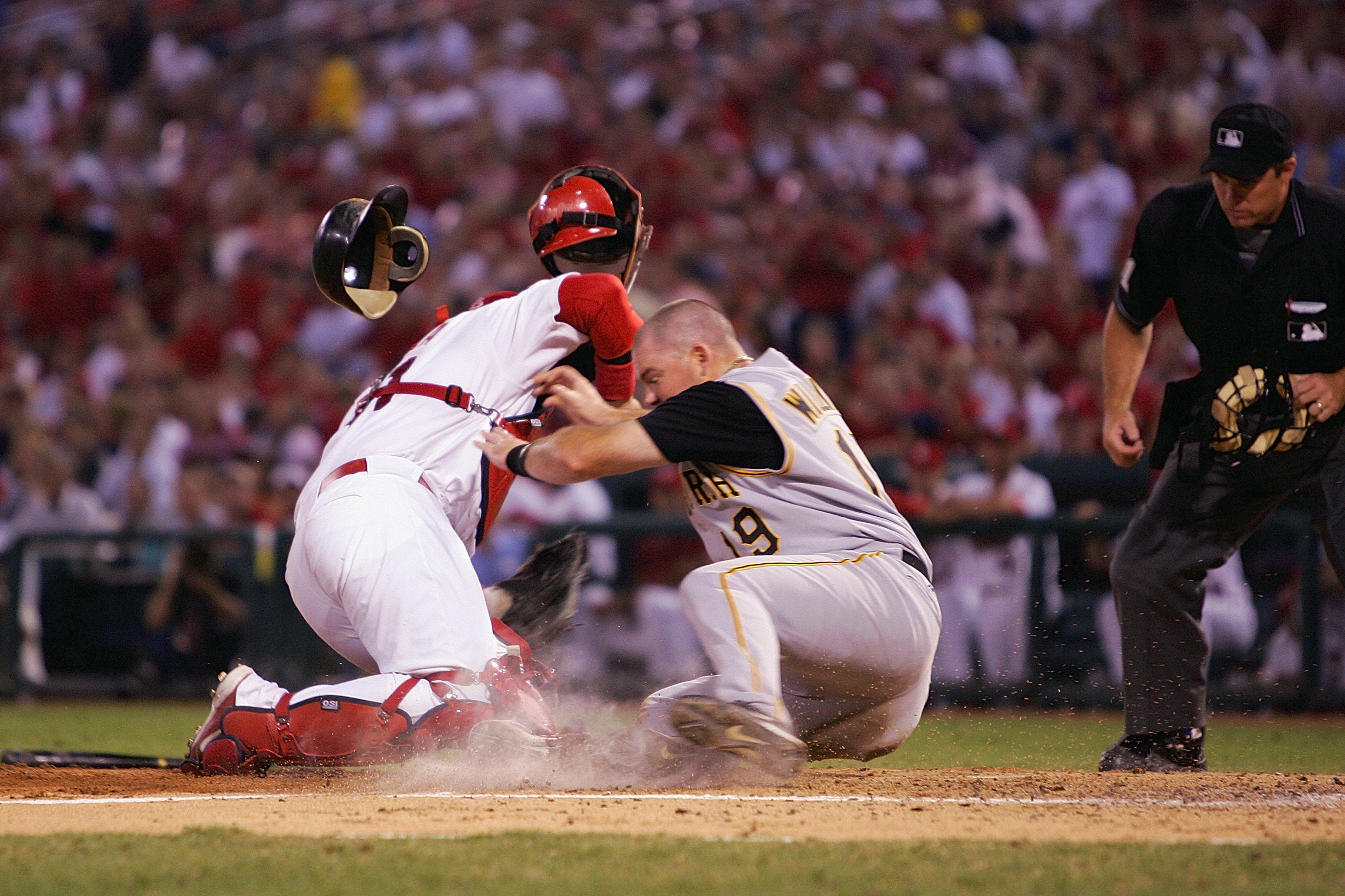 ST. LOUIS - SEPTEMBER 12:  Ty Wigginton #19 of the Pittsburgh Pirates collides with catcher Yadier Molina #41 of the St. Louis Cardinals at home plate during a game at Busch Stadium on September 12, 2005 in St. Louis, Missouri.  The Cardinals won 4-3.  (P