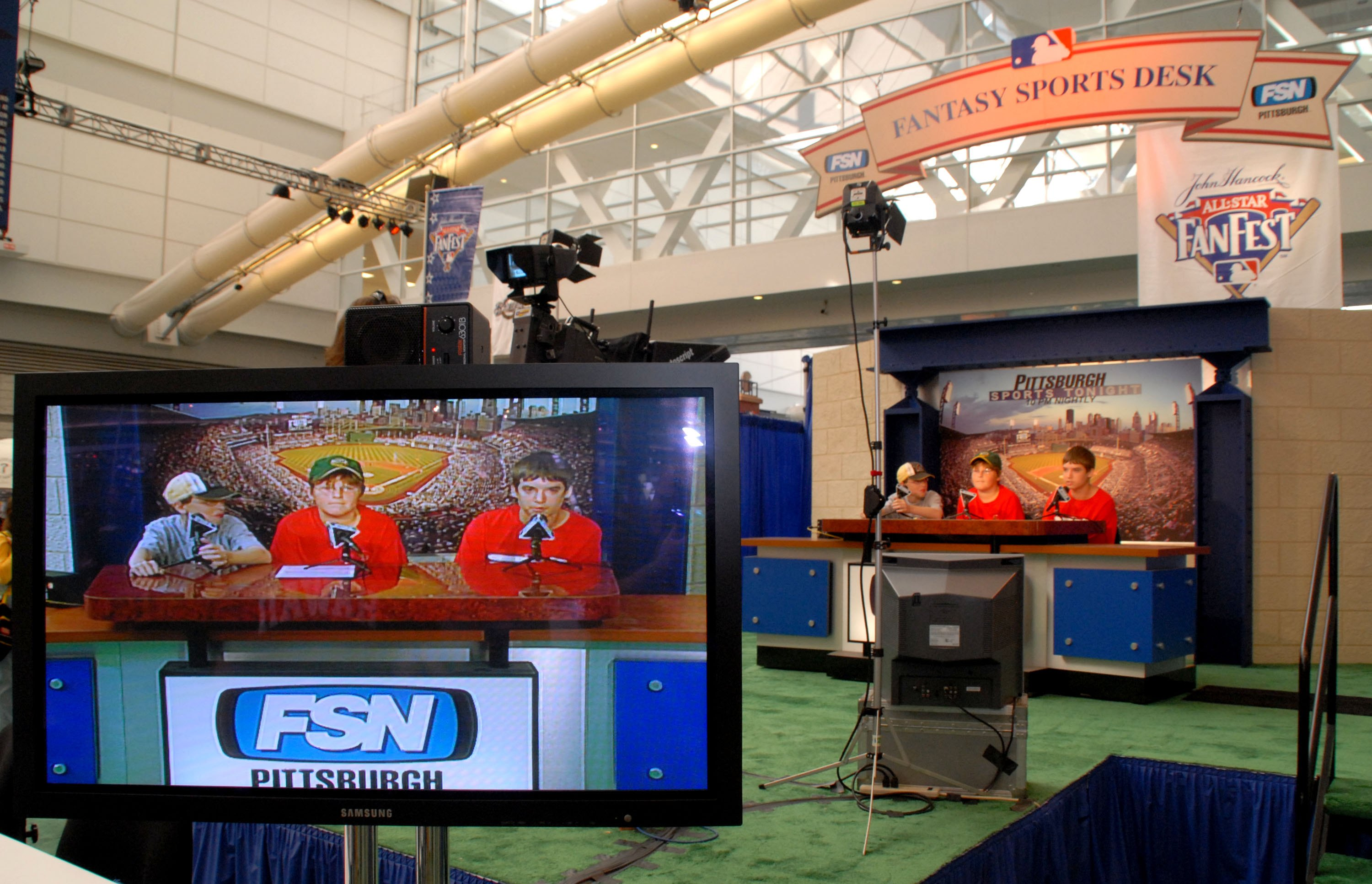 PITTSBURGH - JULY 7: (L-R) Fans Michael Kutilek, 12, Griffin Conley, 11, and Brody Smith, 13, of Oakmont, Pennsylvania, participate in a fantasy sports broadcast during the opening day of Fan Fest for the Major League Baseball 2006 All-Star game at the Da