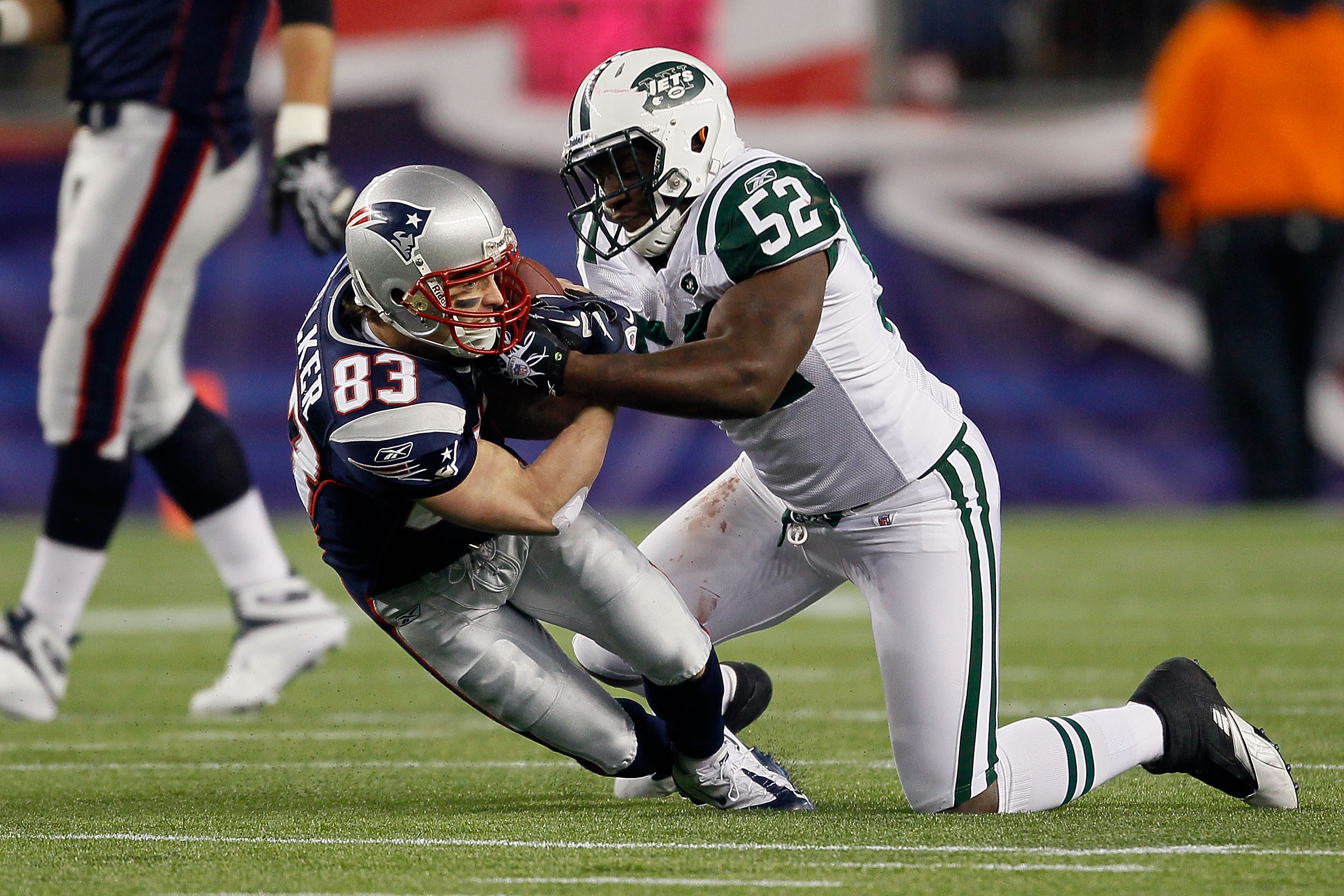 FOXBORO, MA - DECEMBER 06:  Wes Welker #83 of the New England Patriots makes a reception in the first half against David Harris #52 of the New York Jets at Gillette Stadium on December 6, 2010 in Foxboro, Massachusetts.  (Photo by Jim Rogash/Getty Images)