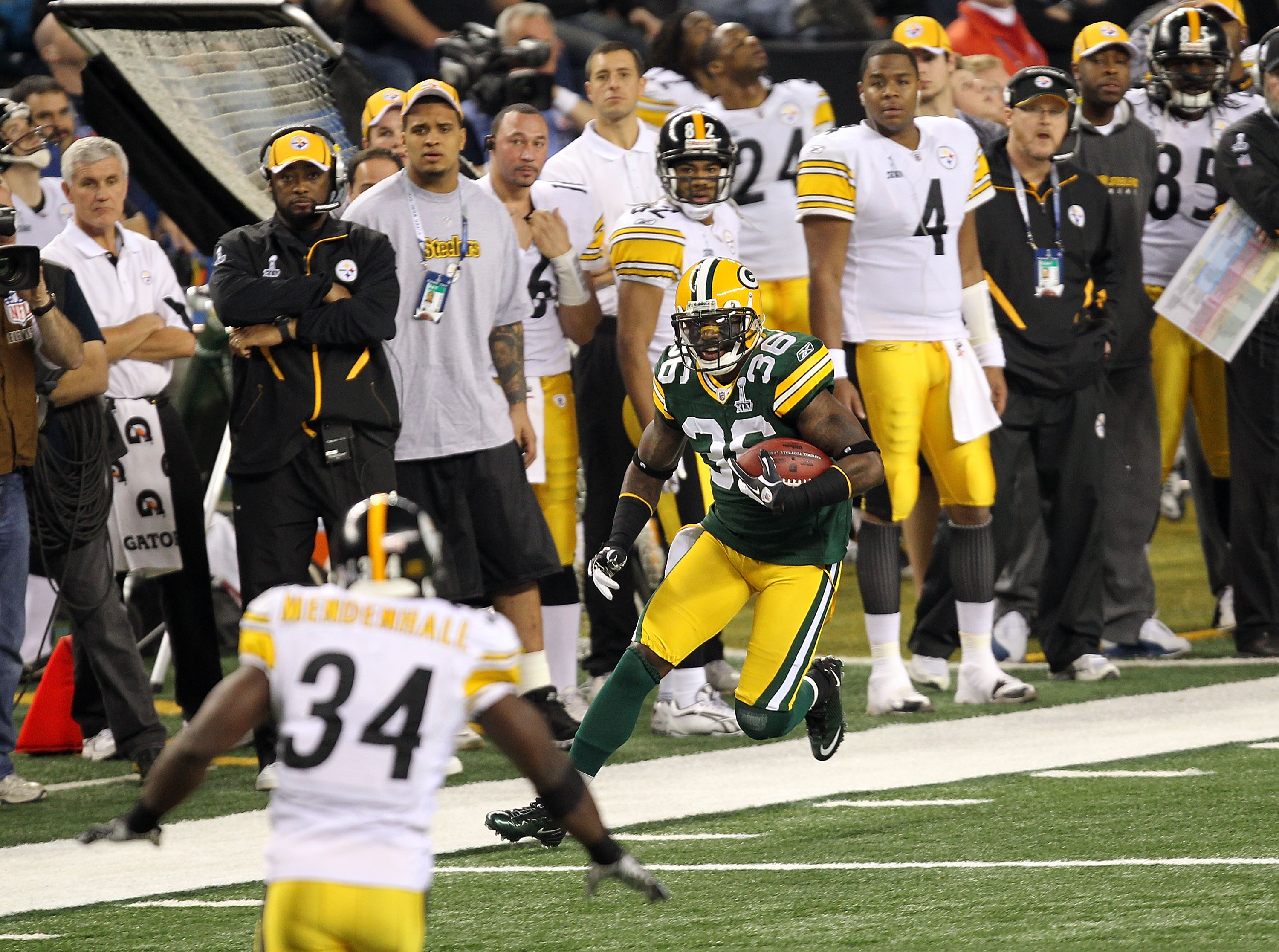 ARLINGTON, TX - FEBRUARY 06:  Nick Collins #36 of the Green Bay Packers returns an interception for a touchdown against Rashard Mendenhall #34 of the Pittsburgh Steelers during Super Bowl XLV at Cowboys Stadium on February 6, 2011 in Arlington, Texas.  (P