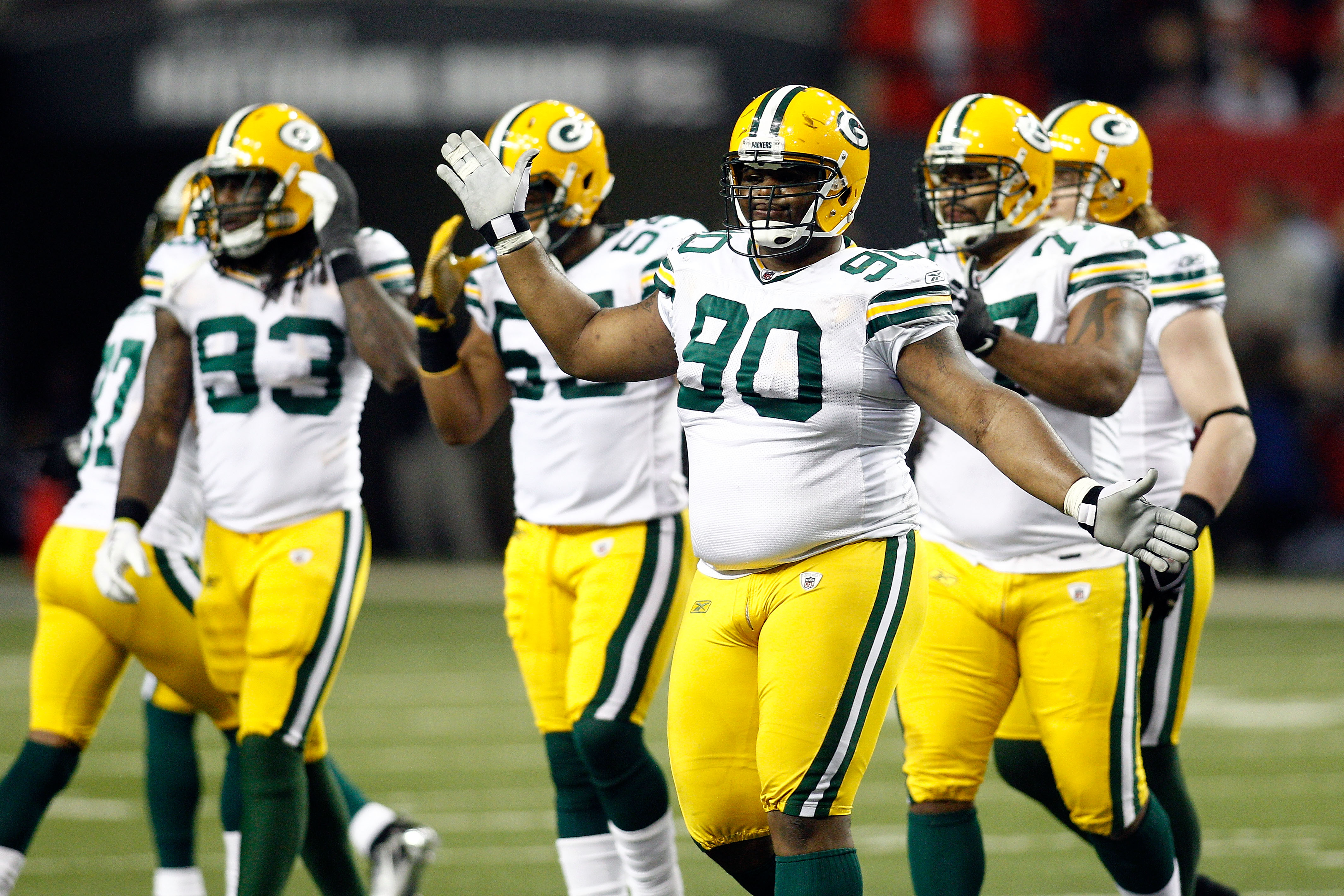 ATLANTA, GA - JANUARY 15:  B.J. Raji #90 of  the Green Bay Packers celebrates a defensive play against the Atlanta Falcons during their 2011 NFC divisional playoff game at Georgia Dome on January 15, 2011 in Atlanta, Georgia.  (Photo by Chris Graythen/Get