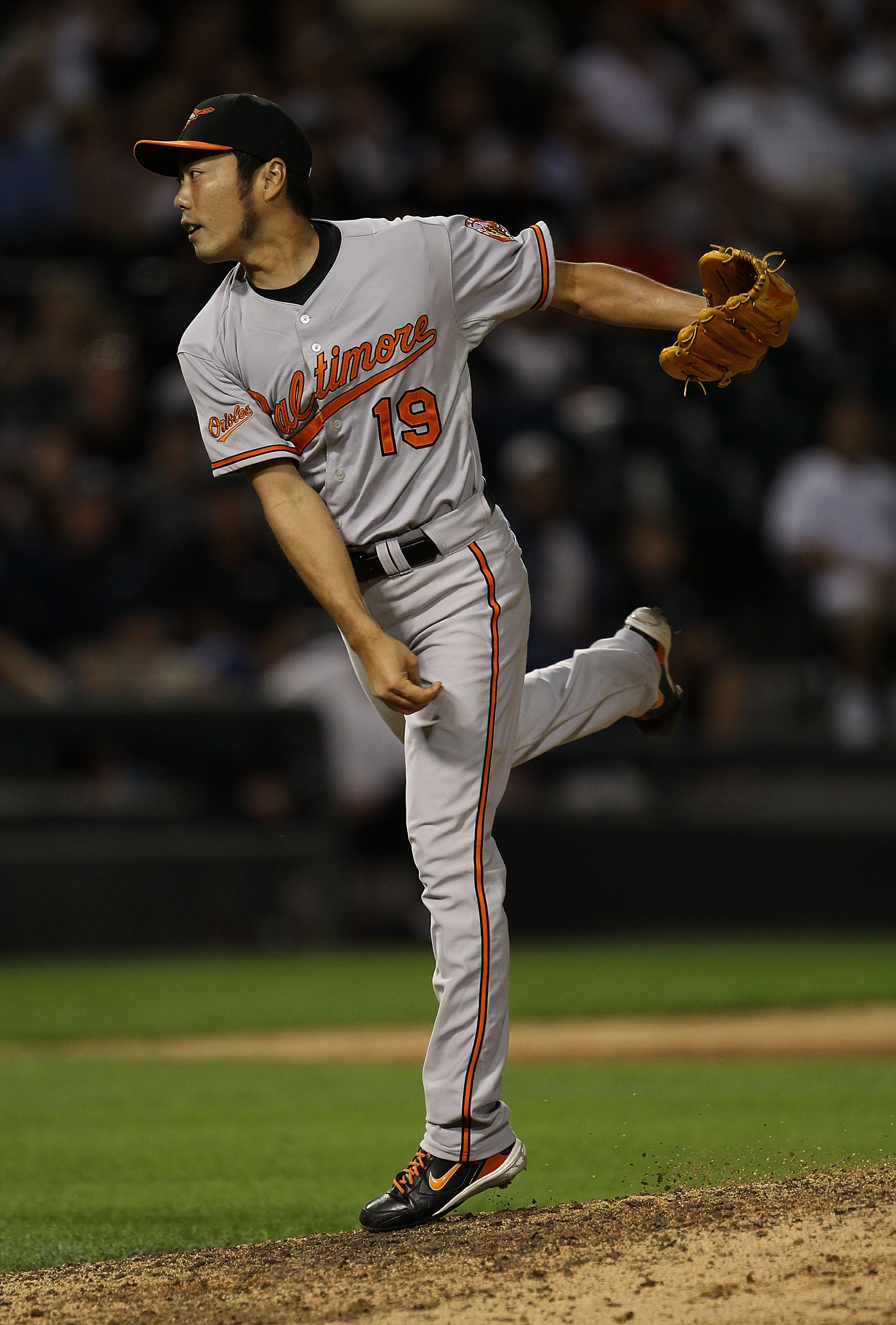 CHICAGO - AUGUST 25: Koji Uehara #19 of the Baltimore Orioles follows through after pitching in the 9th inning against the Chicago White Sox at U.S. Cellular Field on August 25, 2010 in Chicago, Illinois. The Orioles defeated the White Sox 4-3. (Photo by