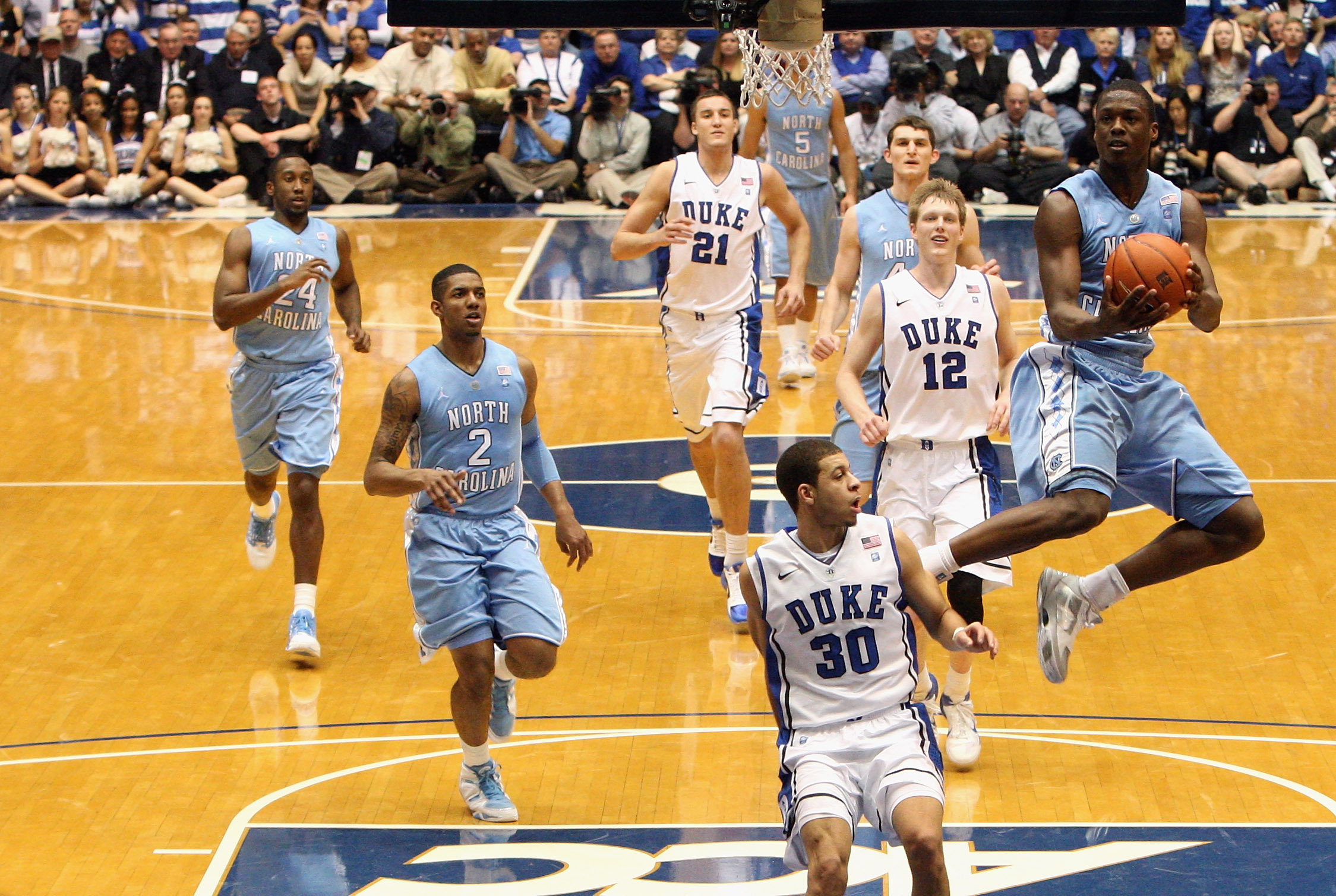 DURHAM, NC - FEBRUARY 09:  Harrison Barnes #40 of the North Carolina Tar Heels drives to the basket against Seth Curry #30 of the Duke Blue Devils during their game at Cameron Indoor Stadium on February 9, 2011 in Durham, North Carolina.  (Photo by Street