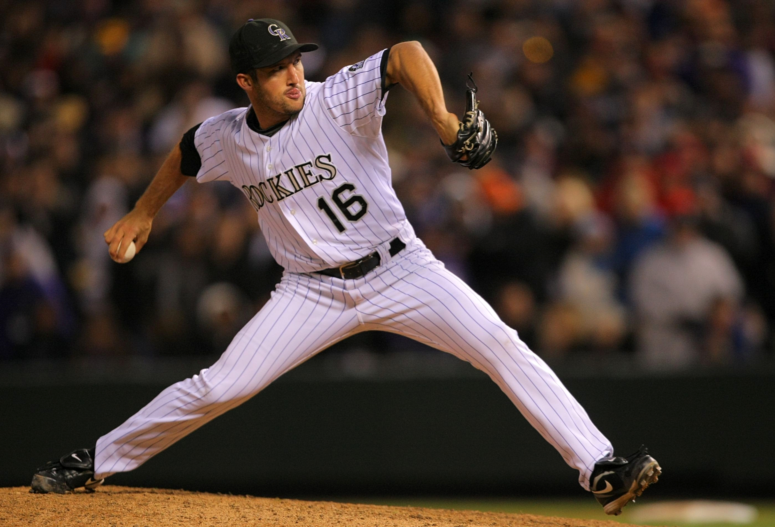 DENVER - OCTOBER 11:  Huston Street #16 of the Colorado Rockies pitches against the Philadelphia Phillies in the ninth inning in Game Four of the NLDS during the 2009 MLB Playoffs at Coors Field on October 12, 2009 in Denver, Colorado.  (Photo by Doug Pen