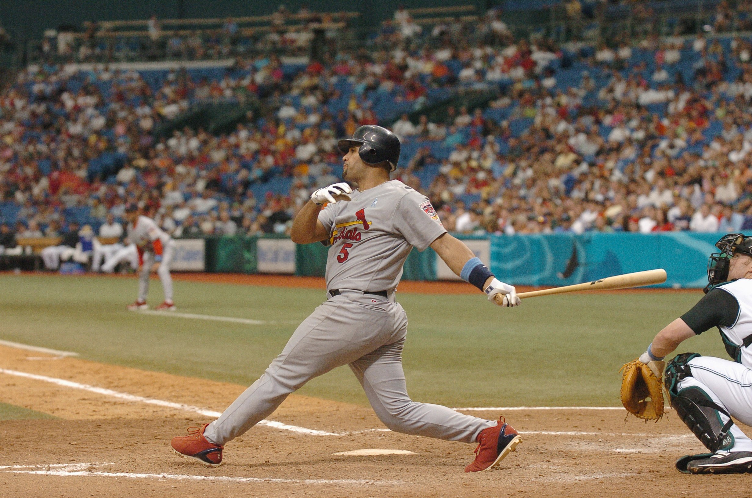 ST. PETERSBURGH, FLORIDA - JUNE 19:  Albert Pujols #5 of the St. Louis Cardinals swings at the pitch during the game against the Tampa Bay Devil Rays at Tampa Bay Devil Rays Stadium on June 19,2005 in St. Petersburg, Florida. (Photo by: Steve Kovich/Getty