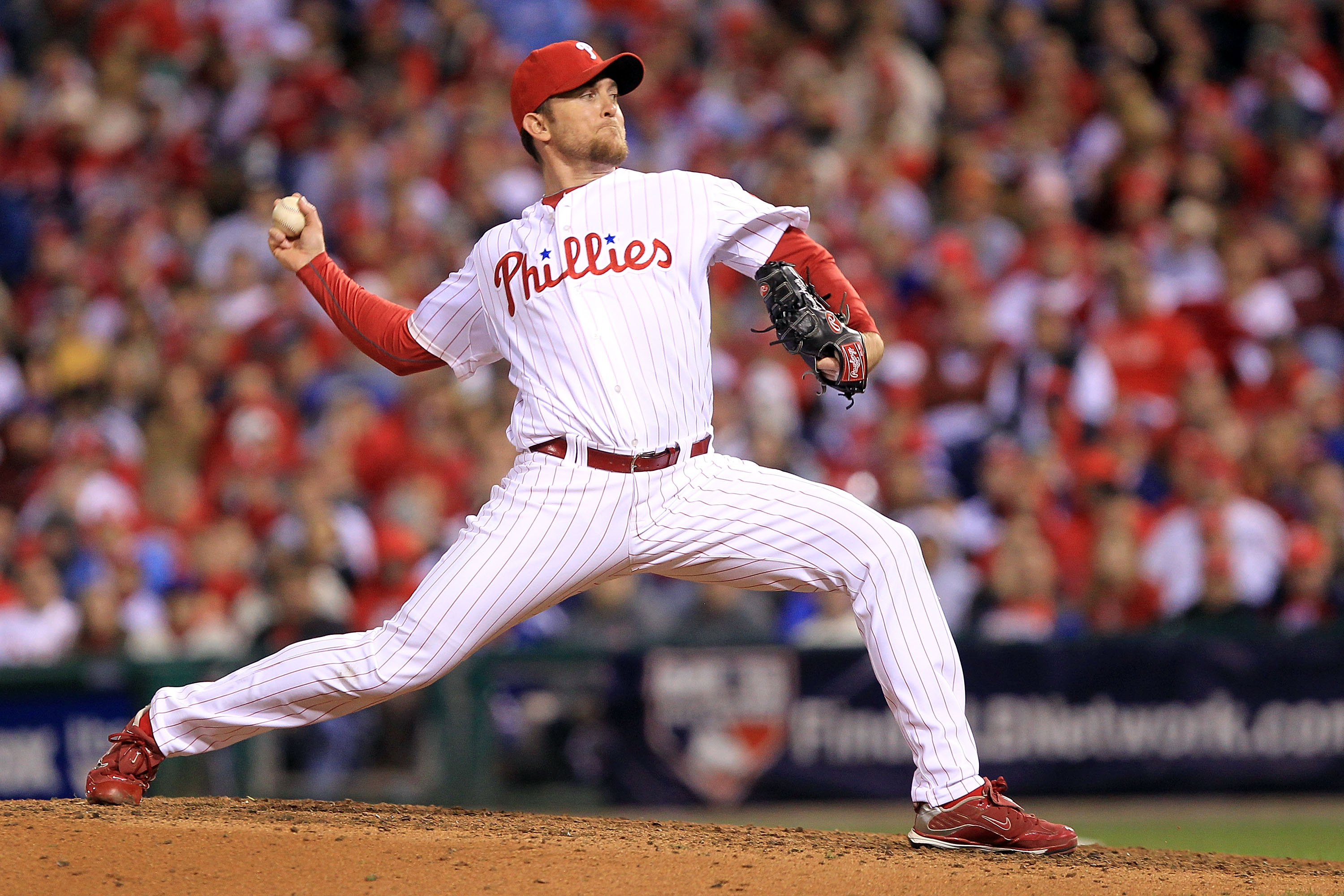 PHILADELPHIA - OCTOBER 16:  Brad Lidge #54 of the Philadelphia Phillies pitches in the ninth inning against the San Francisco Giants in Game One of the NLCS during the 2010 MLB Playoffs at Citizens Bank Park on October 16, 2010 in Philadelphia, Pennsylvan
