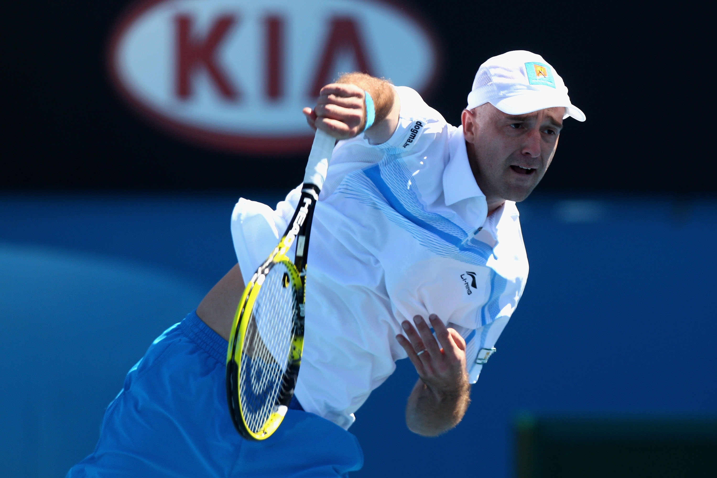 MELBOURNE, AUSTRALIA - JANUARY 19:  Ivan Ljubicic of Croatia serves during his second round match against Benoit Paire of France during day three of the 2011 Australian Open at Melbourne Park on January 19, 2011 in Melbourne, Australia.  (Photo by Ryan Pi