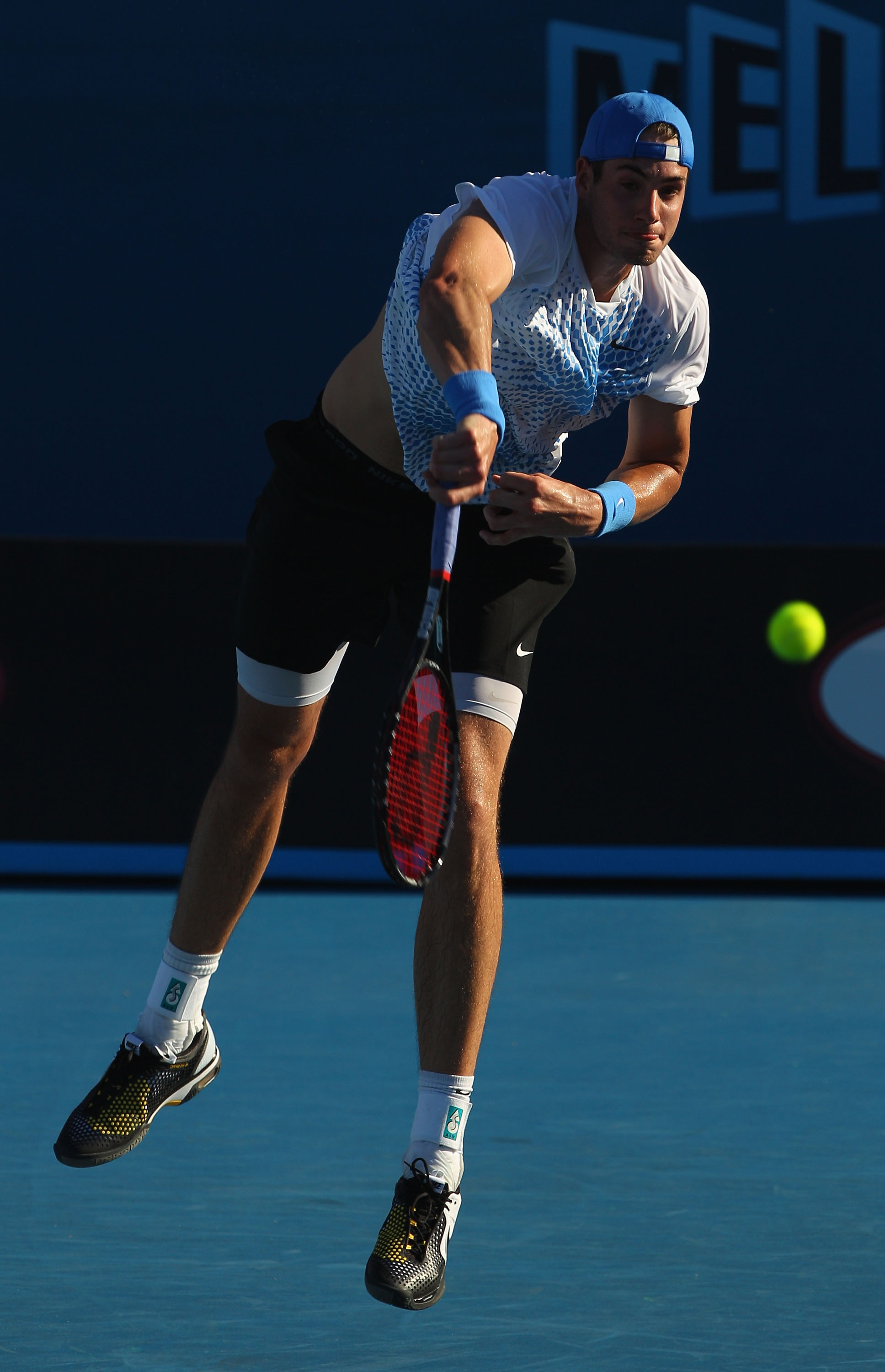 MELBOURNE, AUSTRALIA - JANUARY 20:  John Isner of United States of America serves in his second round match against Radek Stepanek of Czech Republic during day four of the 2011 Australian Open at Melbourne Park on January 20, 2011 in Melbourne, Australia.