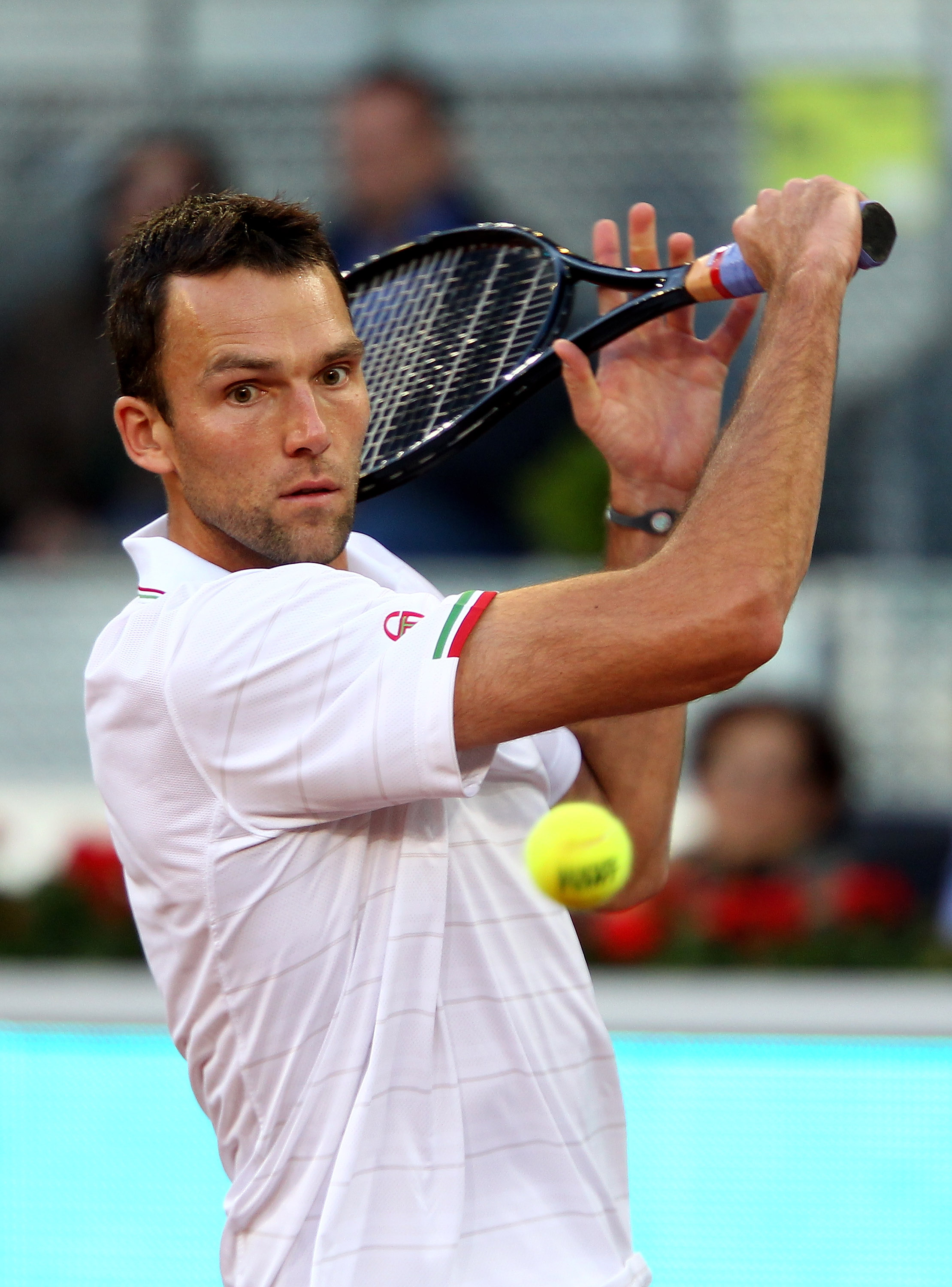 MADRID, SPAIN - MAY 11:  Ivo Karlovic of Croatia  plays a backhand against  Fernando Verdasco of Spain in their second round match during the Mutua Madrilena Madrid Open tennis tournament at the Caja Magica on on May 11, 2010 in Madrid, Spain.  (Photo by