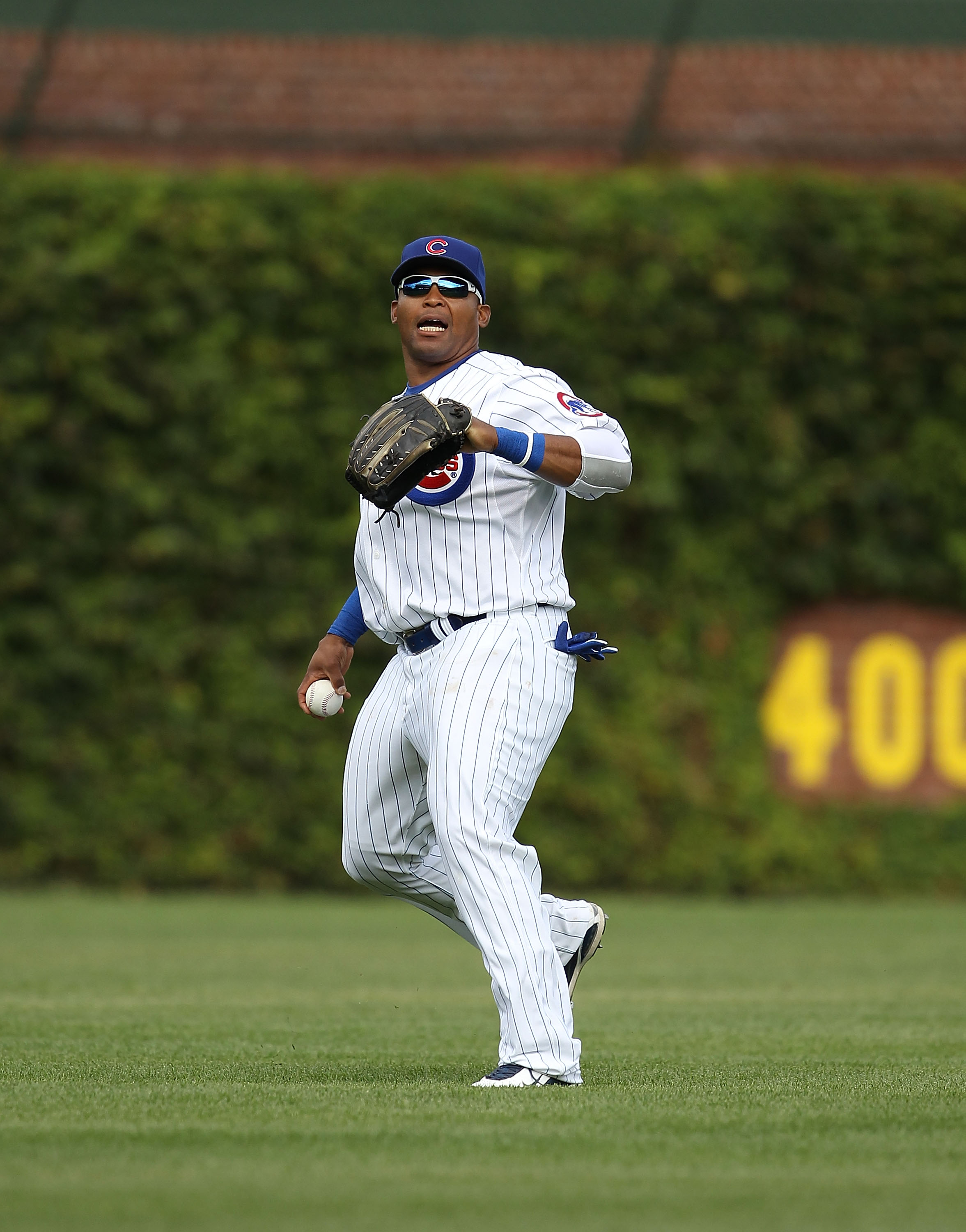 CHICAGO - SEPTEMBER 05: Marlon Byrd #24 of the Chicago Cubs prepares to throw the ball to the infield against the New York Mets at Wrigley Field on September 5, 2010 in Chicago, Illinois. The Mets defeated the Cubs 18-5. (Photo by Jonathan Daniel/Getty Im