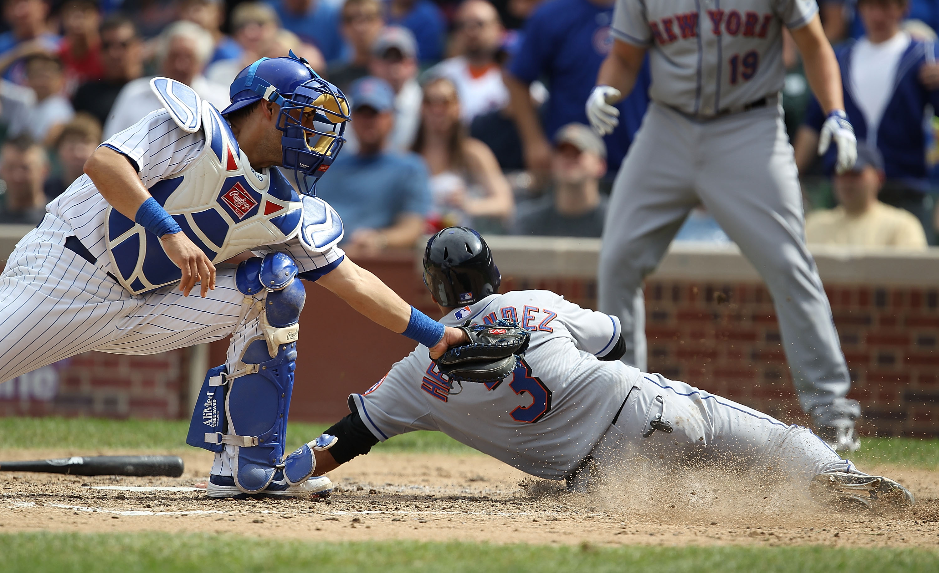 CHICAGO - SEPTEMBER 05: Luis Hernandez #3 of the New York Mets slides into home to score a run past the tag attempt of Geovany Soto #18 of the Chicago Cubs in the 5th inning at Wrigley Field on September 5, 2010 in Chicago, Illinois. (Photo by Jonathan Da