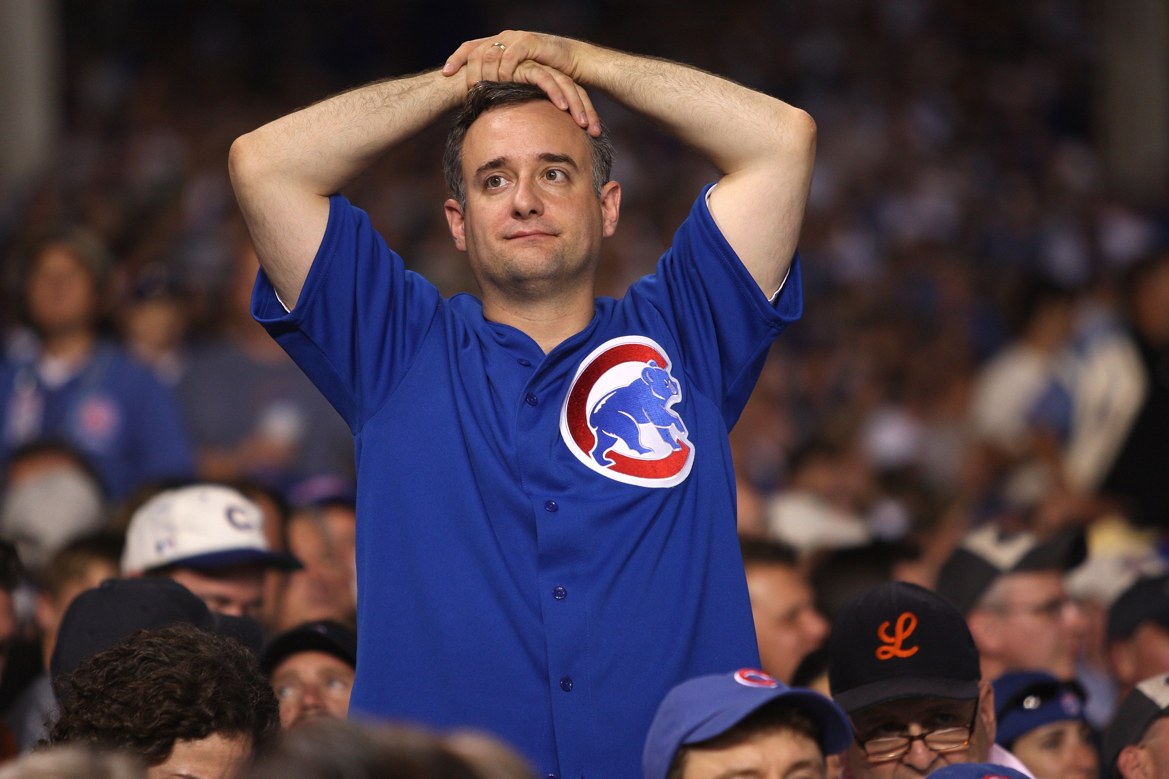 CHICAGO - OCTOBER 06:  A fan of the Chicago Cubs looks on dejected against the Arizona Diamondbacks during Game Three of the National League Divisional Series at Wrigley Field on October 6, 2007 in Chicago, Illinois.  (Photo by Jamie Squire/Getty Images)