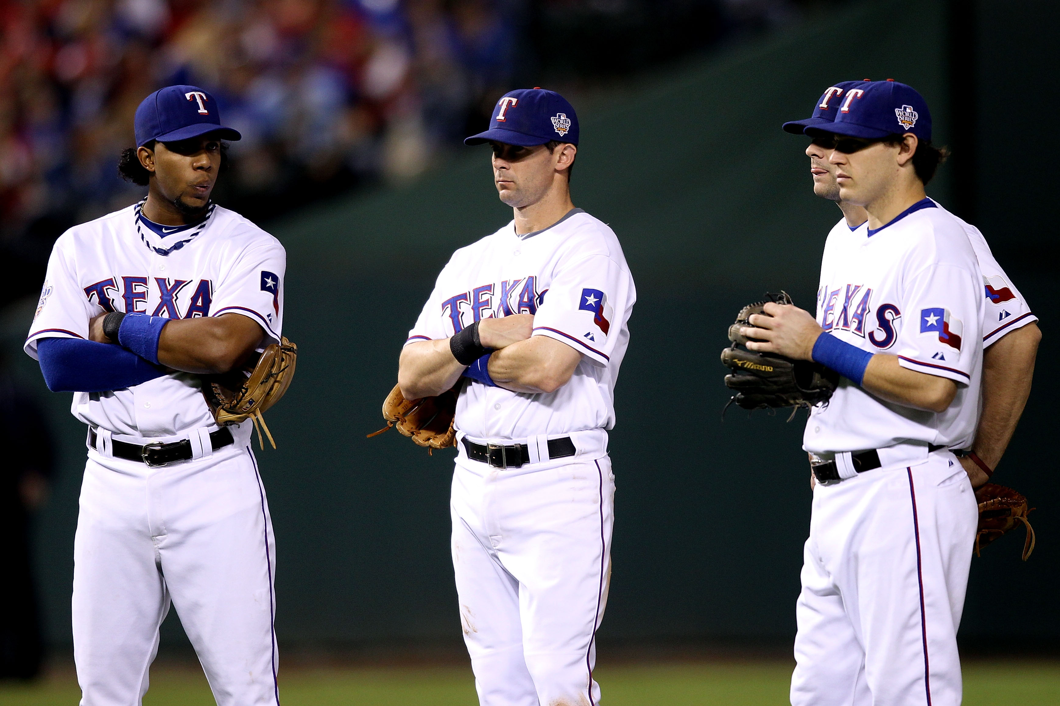 ARLINGTON, TX - OCTOBER 31:  (L-R) Elvis Andrus #1, Michael Young #10, Ian Kinsler #5 and Mitch Moreland #18 of the Texas Rangers wait during a pitching change against the San Francisco Giants in Game Four of the 2010 MLB World Series at Rangers Ballpark