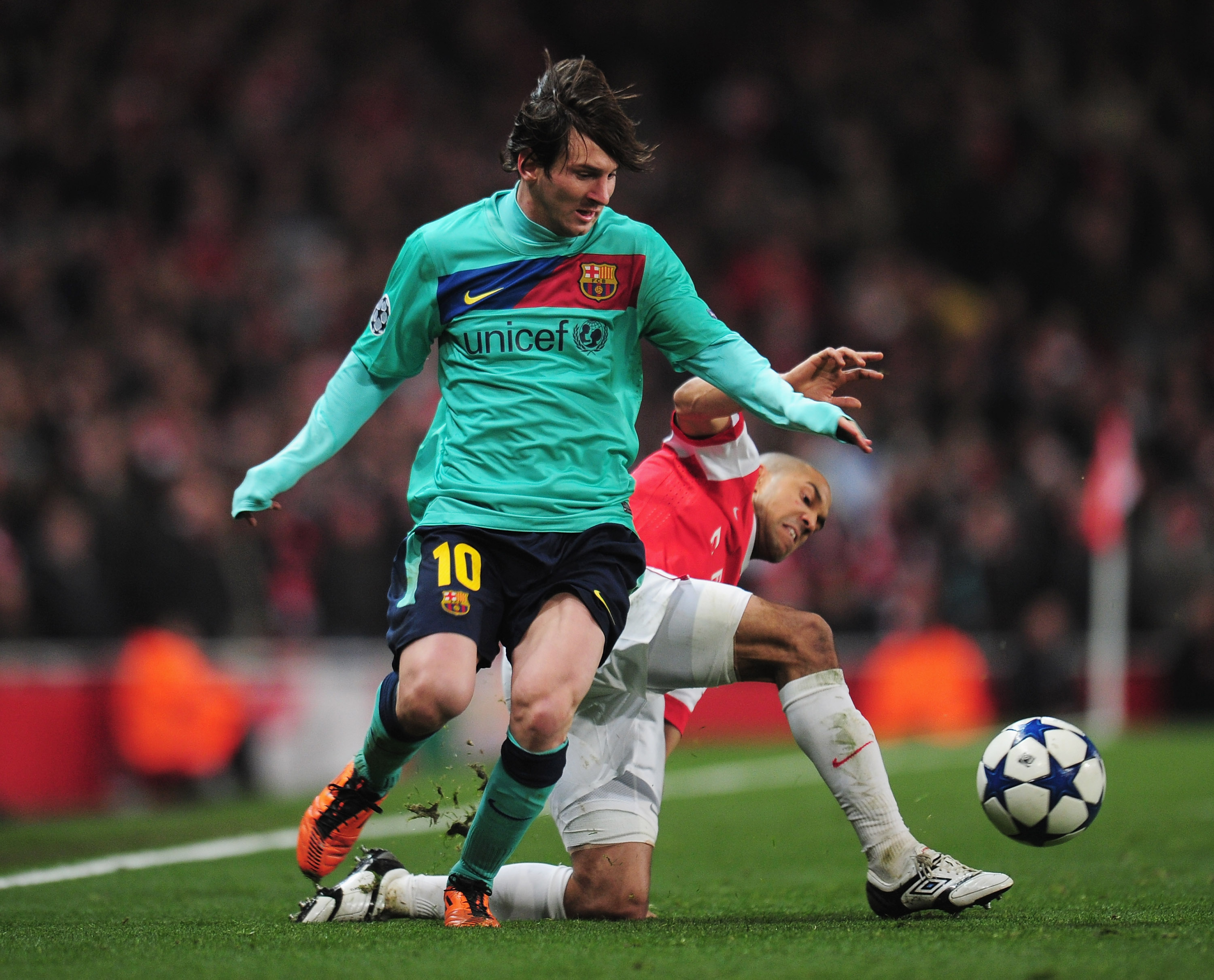 LONDON, ENGLAND - FEBRUARY 16:  Gael Clichy of Arsenal challenges Lionel Messi of Barcelona during the UEFA Champions League round of 16 first leg match between Arsenal and Barcelona at the Emirates Stadium on February 16, 2011 in London, England.  (Photo