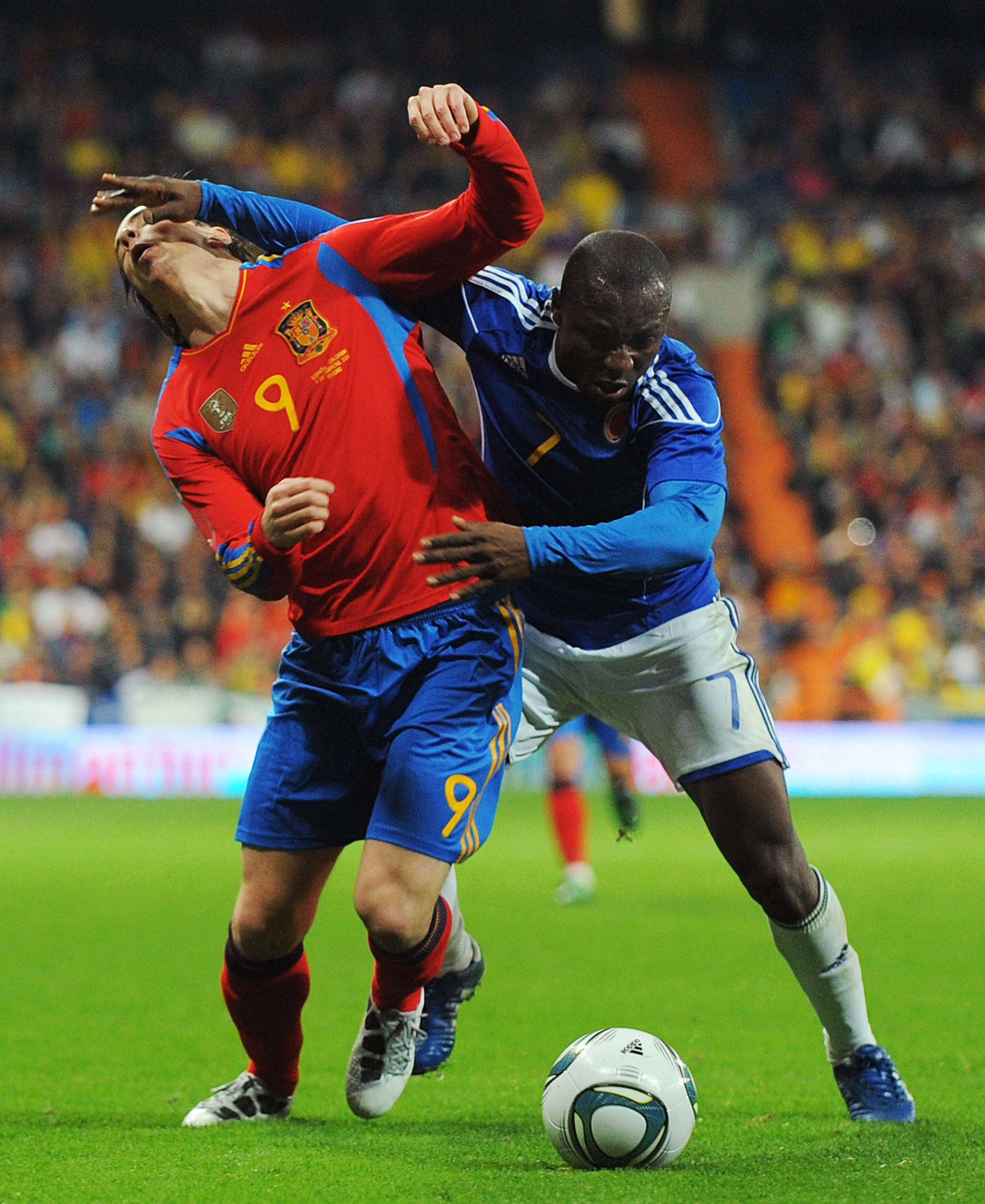 MADRID, SPAIN - FEBRUARY 09:  Fernando Torres (L)  of Spain is fouled by Armero of Colombia during the International friendly match between Spain and Colombia at Estadio Santiago Bernabeu on February 9, 2011 in Madrid, Spain.  (Photo by Denis Doyle/Getty