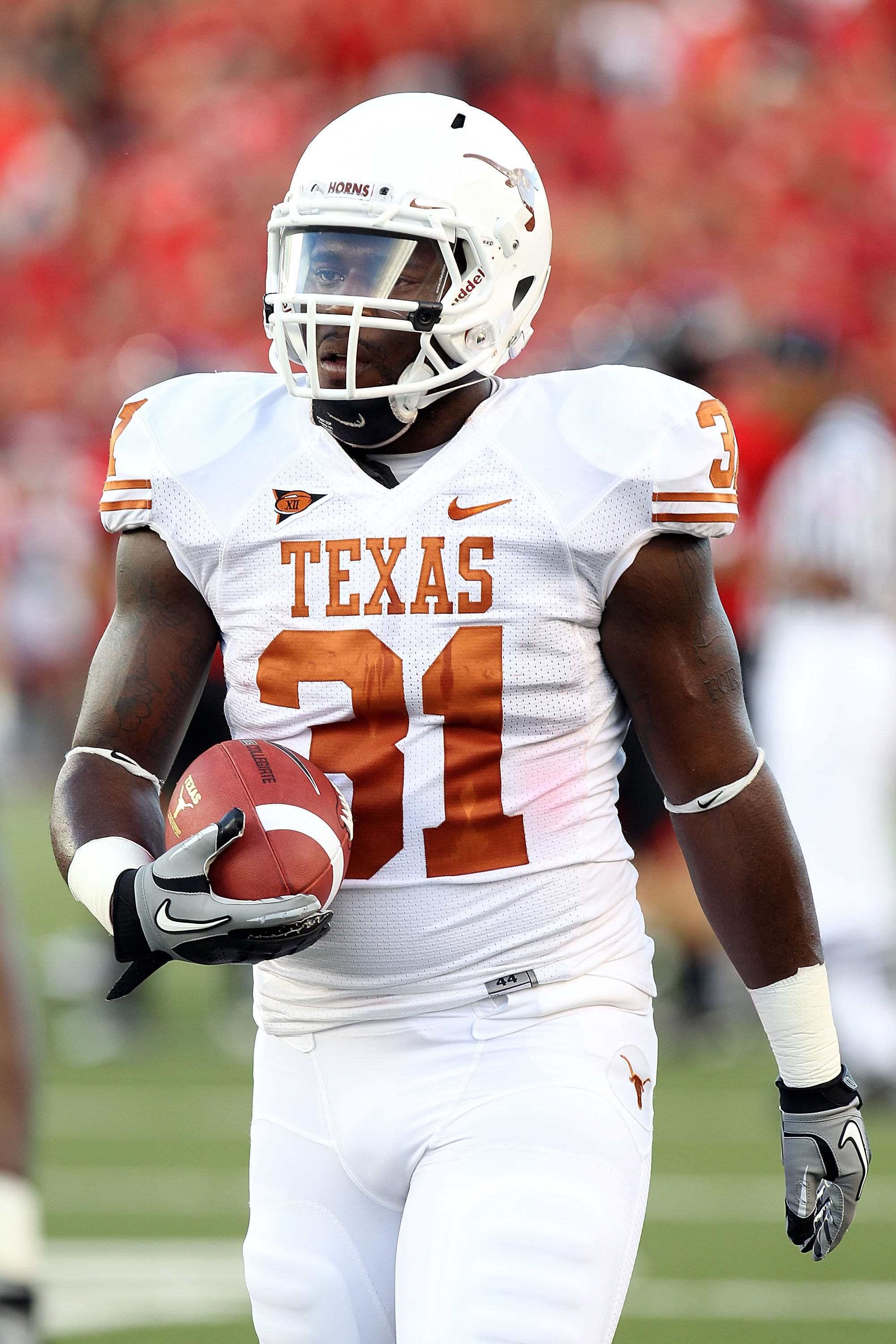 LUBBOCK, TX - SEPTEMBER 18:  Running back Cody Johnson #31 of the Texas Longhorns at Jones AT&T Stadium on September 18, 2010 in Lubbock, Texas.  (Photo by Ronald Martinez/Getty Images)