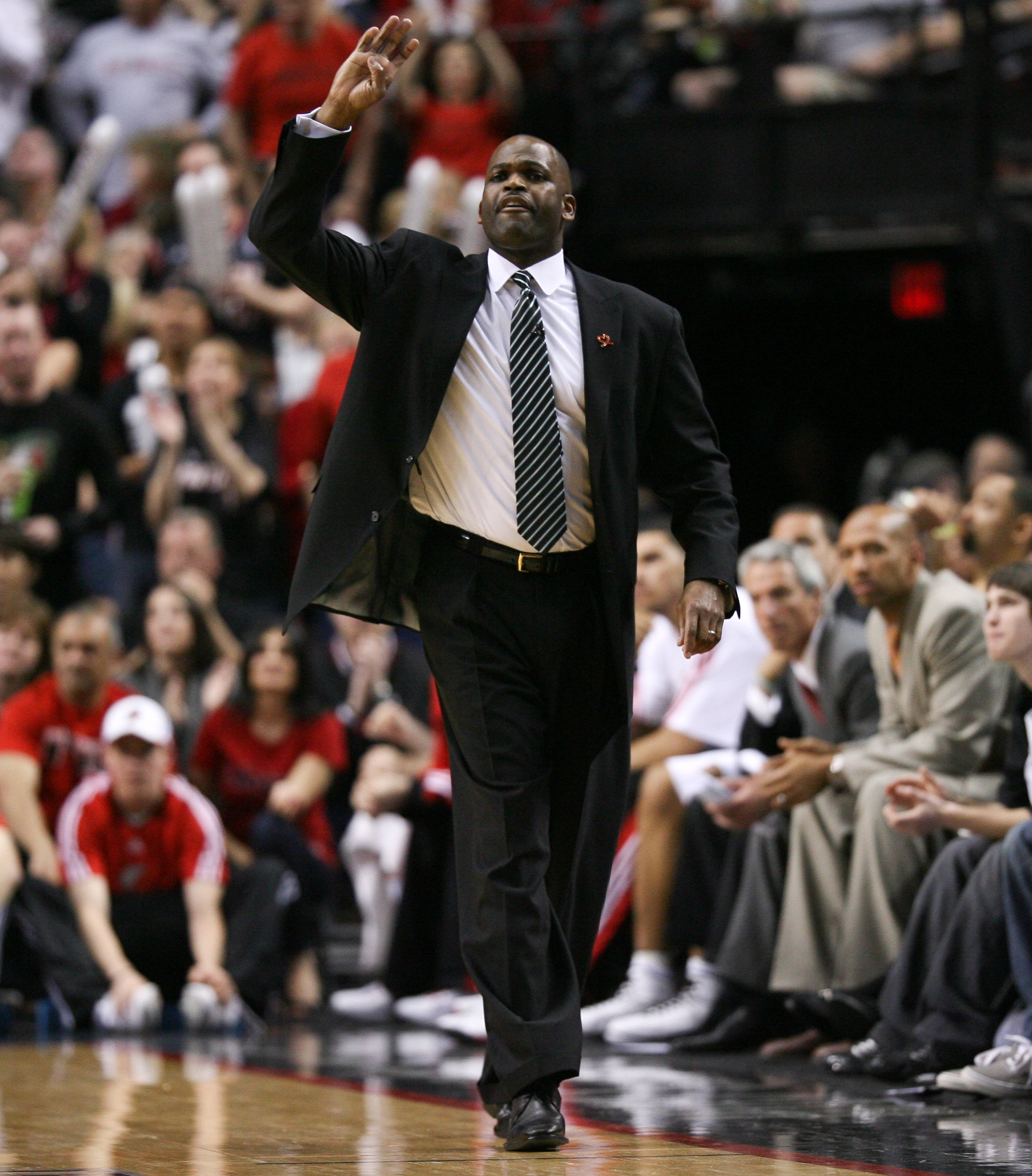 PORTLAND, OR - APRIL 24:  Head coach Nate McMillan of the Portland Trail Blazers calls a play against the Phoenix Suns during Game Four of the Western Conference Quarterfinals of the NBA Playoffs on April 24, 2010 at the Rose Garden in Portland, Oregon. N