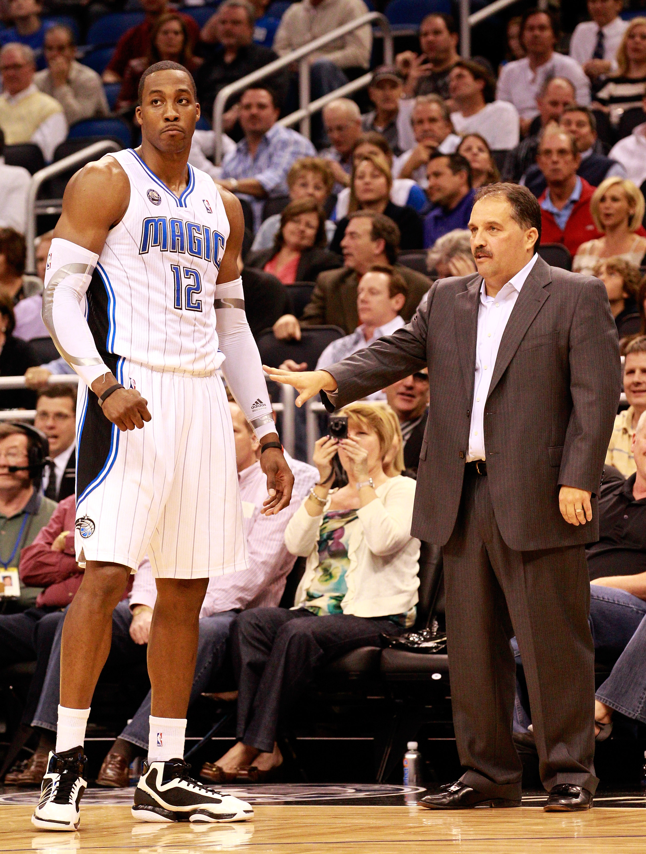 ORLANDO, FL - JANUARY 24:  Head coach Stan Van Gundy of the Orlando Magic talks with Dwight Howard #12 during the game against the Detroit Pistons at Amway Arena on January 24, 2011 in Orlando, Florida.  NOTE TO USER: User expressly acknowledges and agree