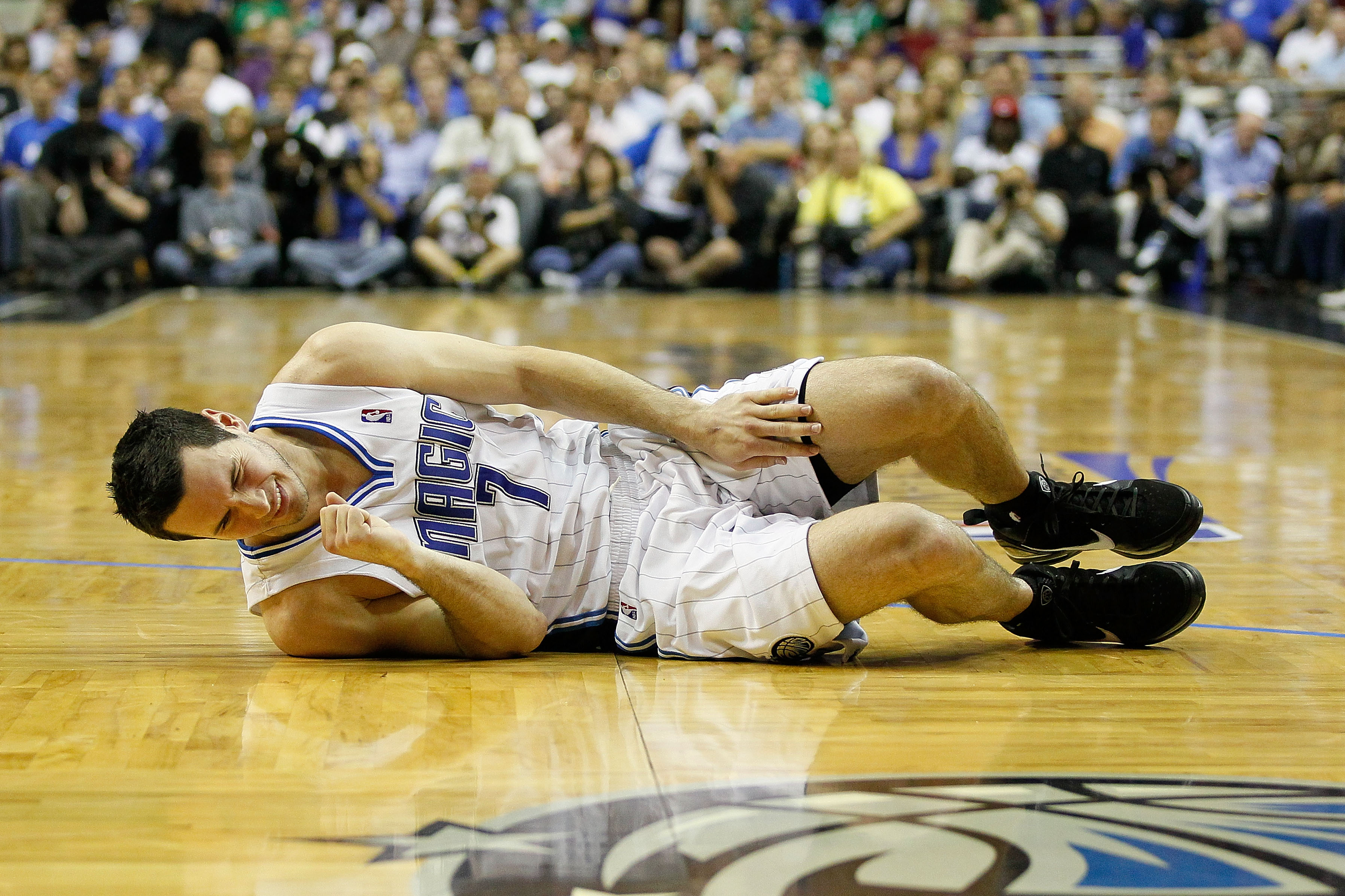 ORLANDO, FL - MAY 18:  J.J. Redick #7 of the Orlando Magic lies on the court in pain against the Boston Celtics in Game Two of the Eastern Conference Finals during the 2010 NBA Playoffs at Amway Arena on May 18, 2010 in Orlando, Florida.  NOTE TO USER: Us