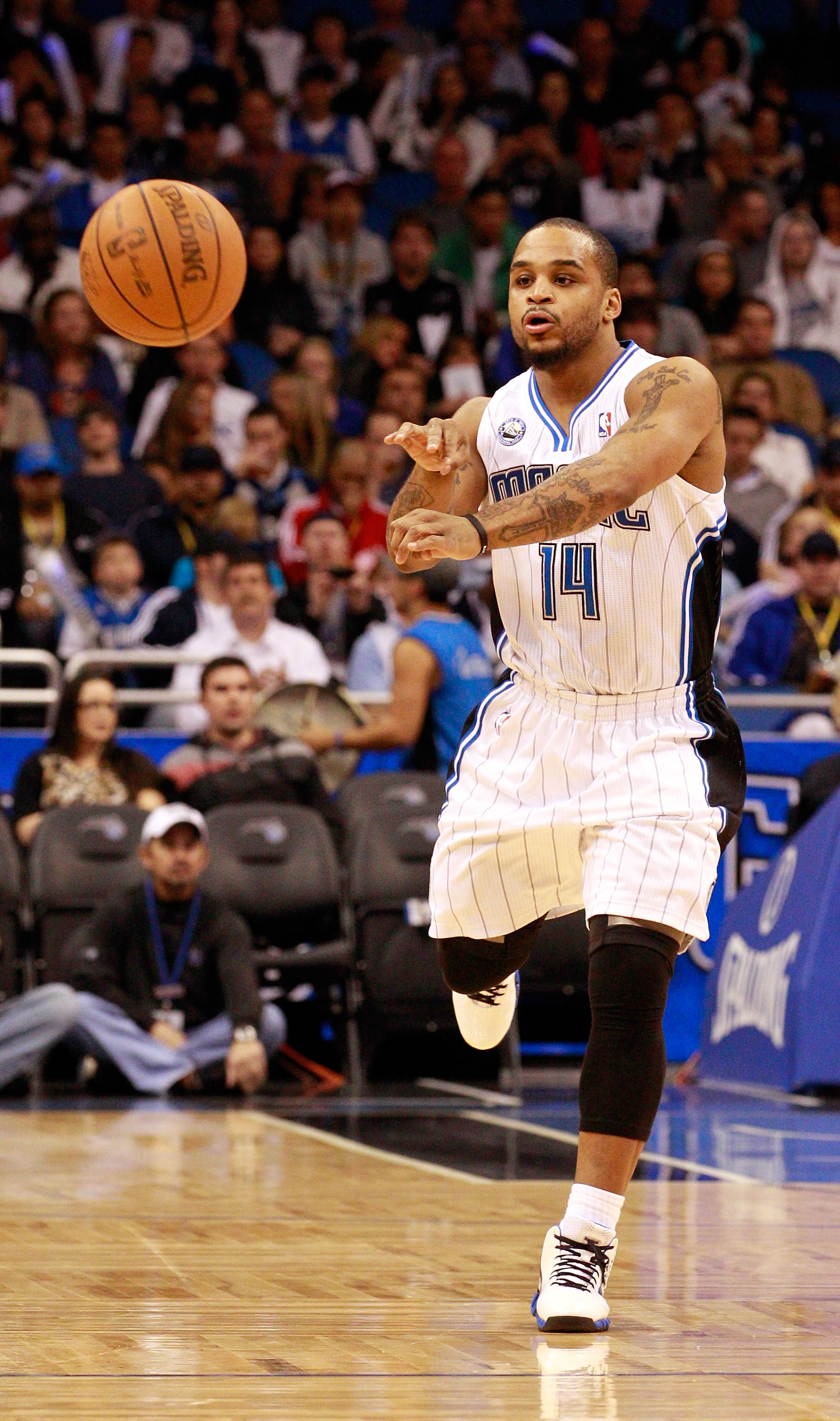 ORLANDO, FL - JANUARY 24:  Jameer Nelson #14 of the Orlando Magic passes the ball during the game against the Detroit Pistons at Amway Arena on January 24, 2011 in Orlando, Florida.  NOTE TO USER: User expressly acknowledges and agrees that, by downloadin