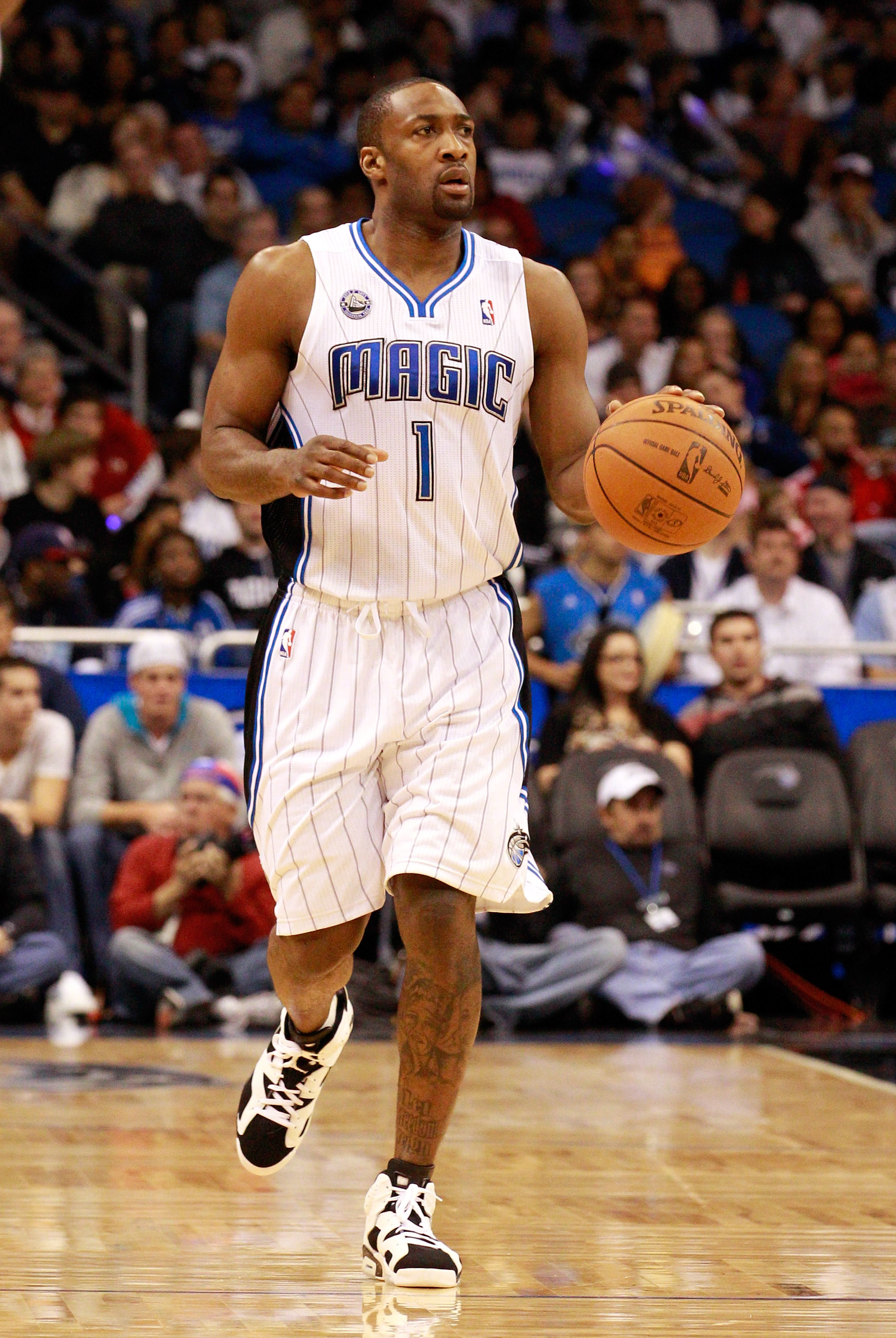 ORLANDO, FL - JANUARY 24:  Gilbert Arenas #1 of the Orlando Magic sets up a play during the game against the Detroit Pistons at Amway Arena on January 24, 2011 in Orlando, Florida.  NOTE TO USER: User expressly acknowledges and agrees that, by downloading