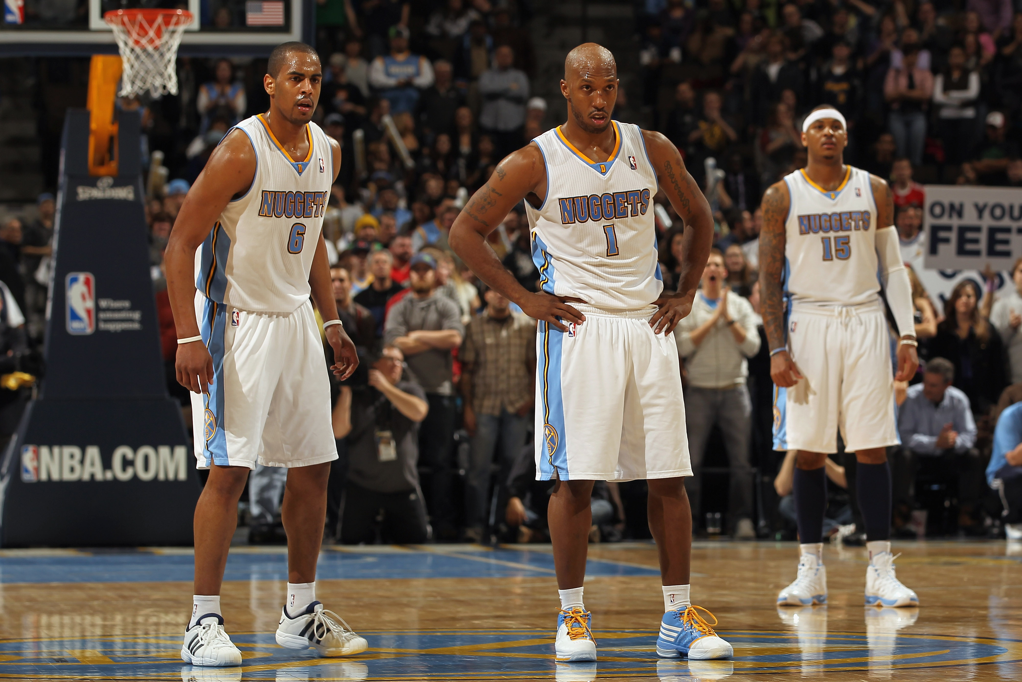 DENVER, CO - FEBRUARY 10:  Arron Afflalo #6, Chauncey Billups #1 and Carmelo Anthony #15 of the Denver Nuggets look on during a break in the action against the Dallas Mavericks during NBA action at the Pepsi Center on February 10, 2011 in Denver, Colorado