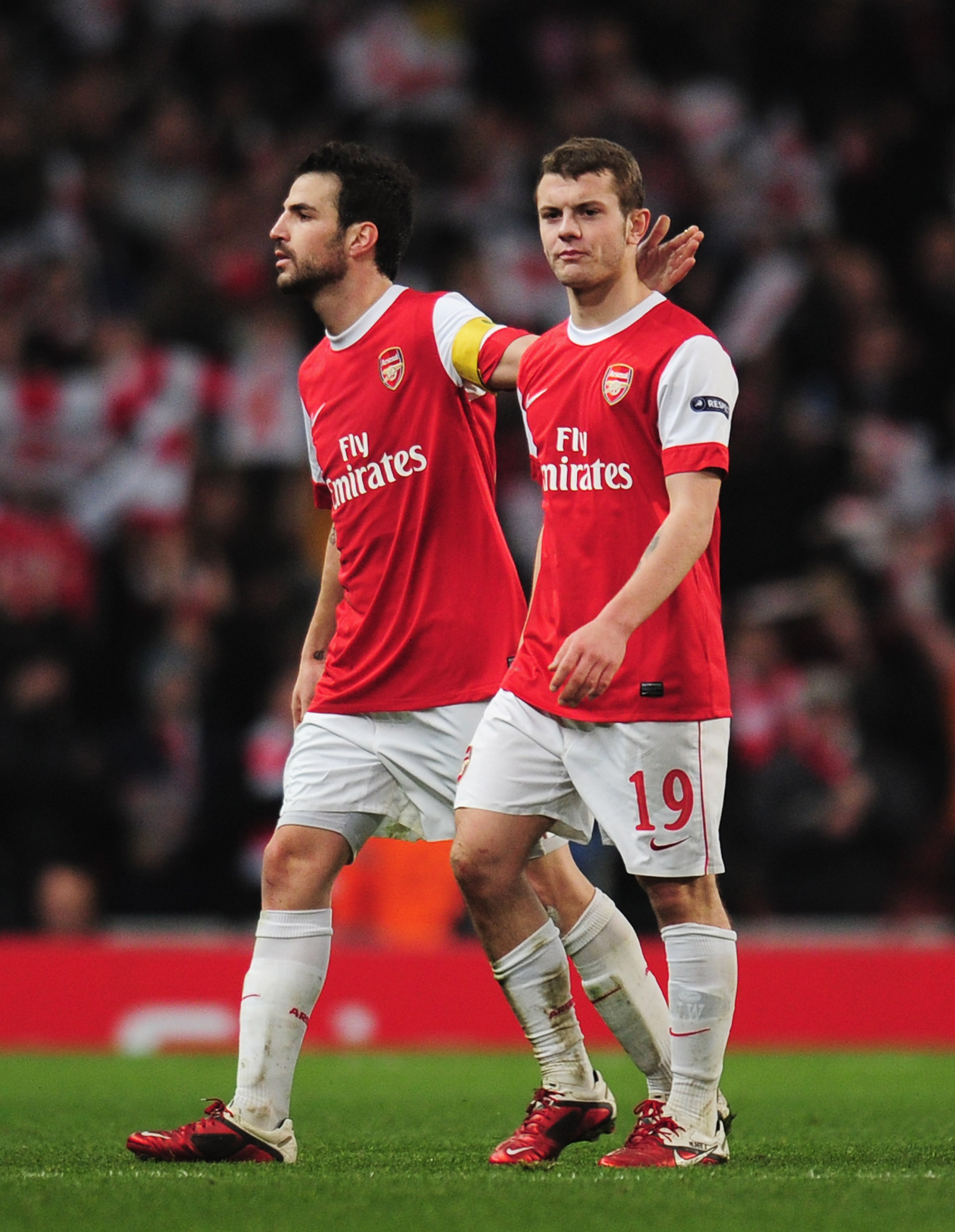 LONDON, ENGLAND - FEBRUARY 16:  Cesc Fabregas (L) of Arsenal congratulates Jack Wilshere after the UEFA Champions League round of 16 first leg match between Arsenal and Barcelona at the Emirates Stadium on February 16, 2011 in London, England.  (Photo by