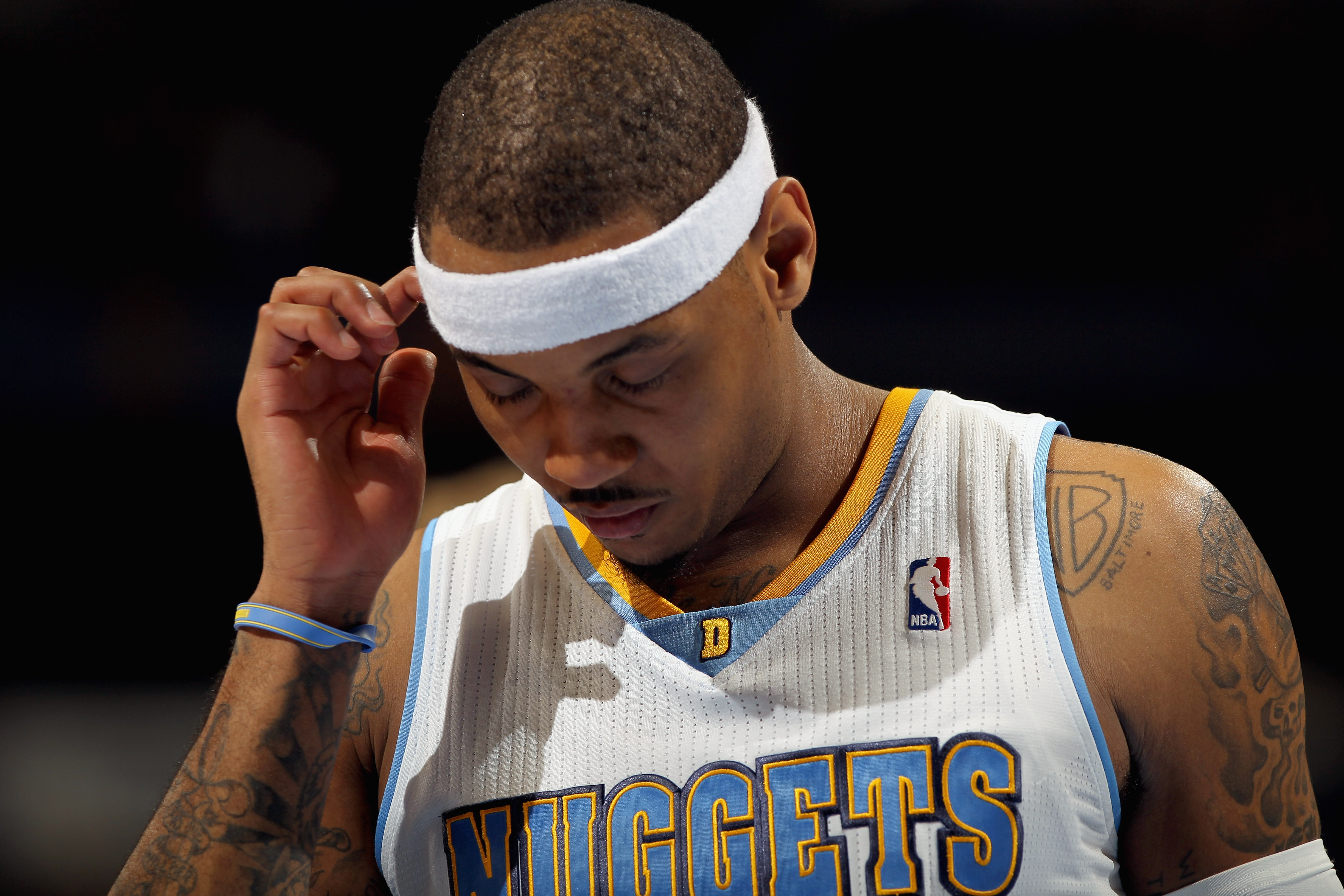 DENVER, CO - FEBRUARY 10:  Carmelo Anthony #15 of the Denver Nuggets looks on during a break in the action against the Dallas Mavericks during NBA action at the Pepsi Center on February 10, 2011 in Denver, Colorado. The Nuggets defeated the Mavericks 121-