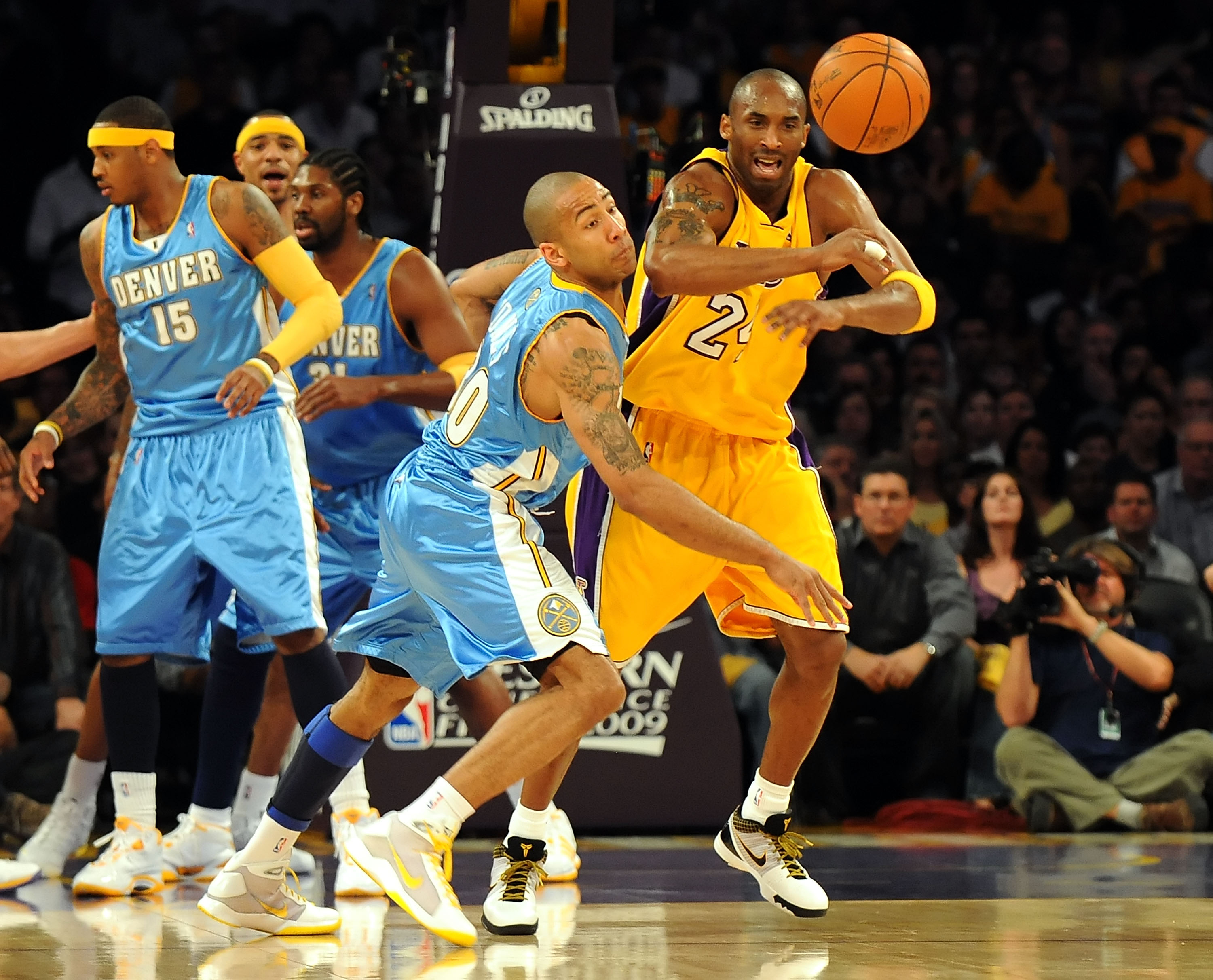 LOS ANGELES, CA - MAY 27:  Dahntay Jones #30 of the Denver Nuggets steals the ball from Kobe Bryant #24 of the Los Angeles Lakers in the first quarter of Game Five of the Western Conference Finals during the 2009 NBA Playoffs at Staples Center on May 27,
