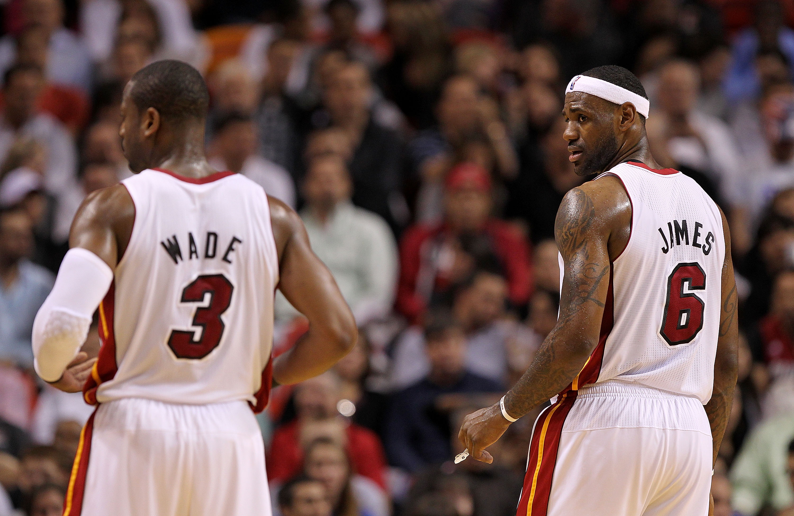 MIAMI, FL - FEBRUARY 08: LeBron James #6 of the Miami Heat looks at Dwyane Wade #3 during a game against the Indiana Pacers at American Airlines Arena on February 8, 2011 in Miami, Florida. NOTE TO USER: User expressly acknowledges and agrees that, by dow