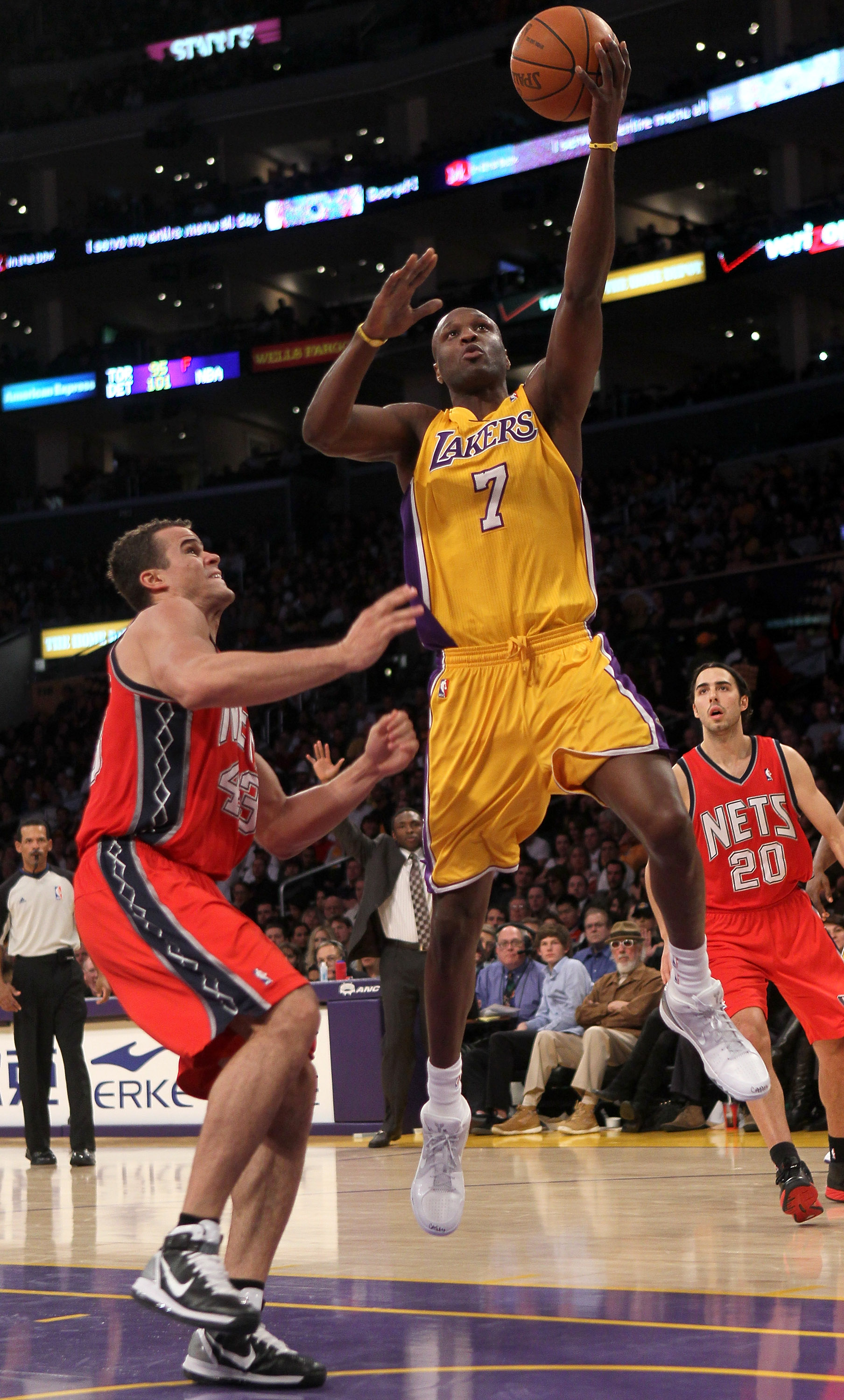 LOS ANGELES, CA - JANUARY 14: Lamar Odom #7 of the Los Angeles Lakers shoots over Kris Humphries #43 of the New Jersey Nets at Staples Center on January 14, 2011 in Los Angeles, California. The Lakers won 100-88.  NOTE TO USER: User expressly acknowledges