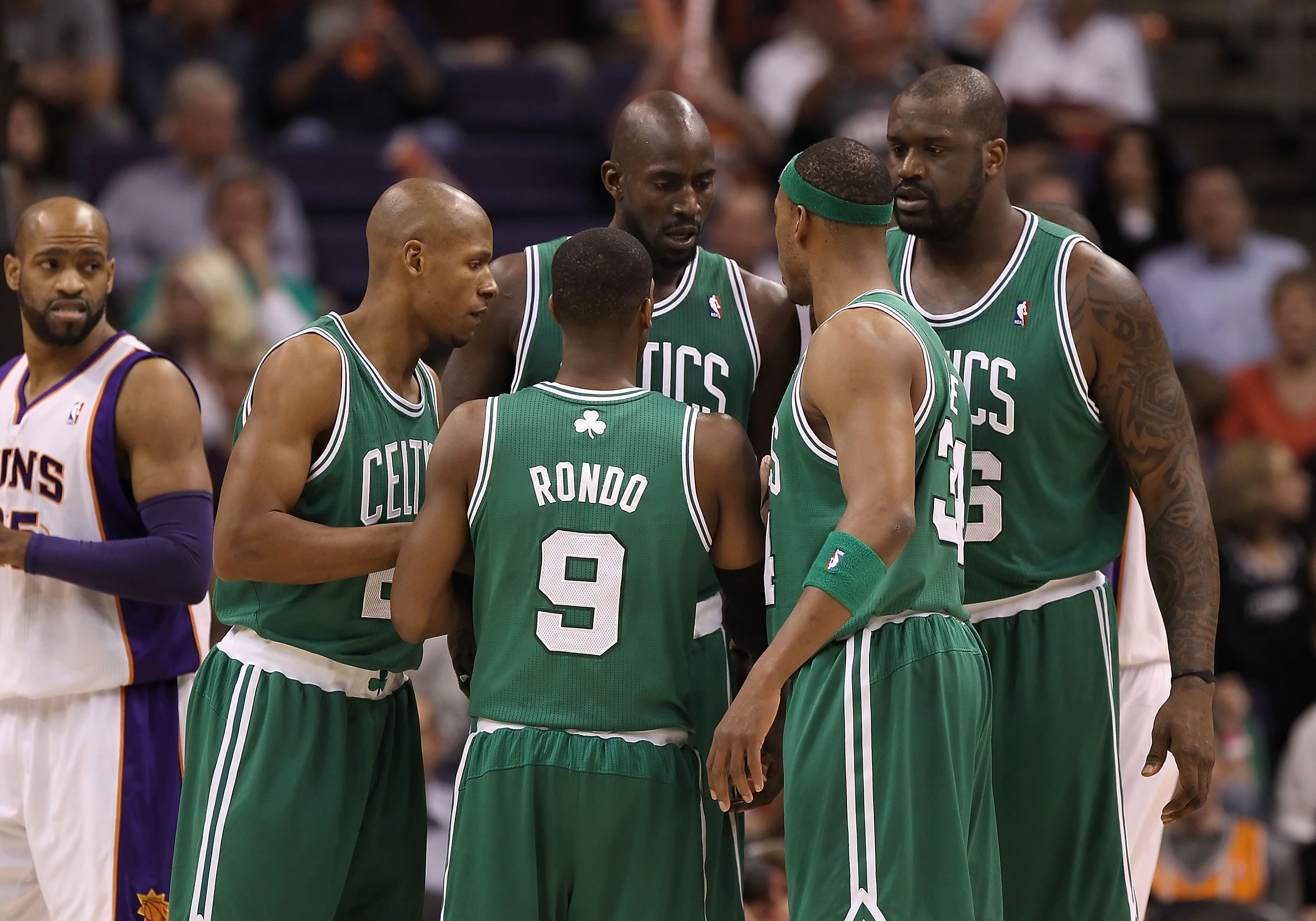 PHOENIX, AZ - JANUARY 28:  (L-R) Ray Allen #20, Rajon Rondo #9, Kevin Garnett #5, Paul Pierce #34 and Shaquille O'Neal #36 of the Boston Celtics huddle up during the NBA game against the Phoenix Suns at US Airways Center on January 28, 2011 in Phoenix, Ar