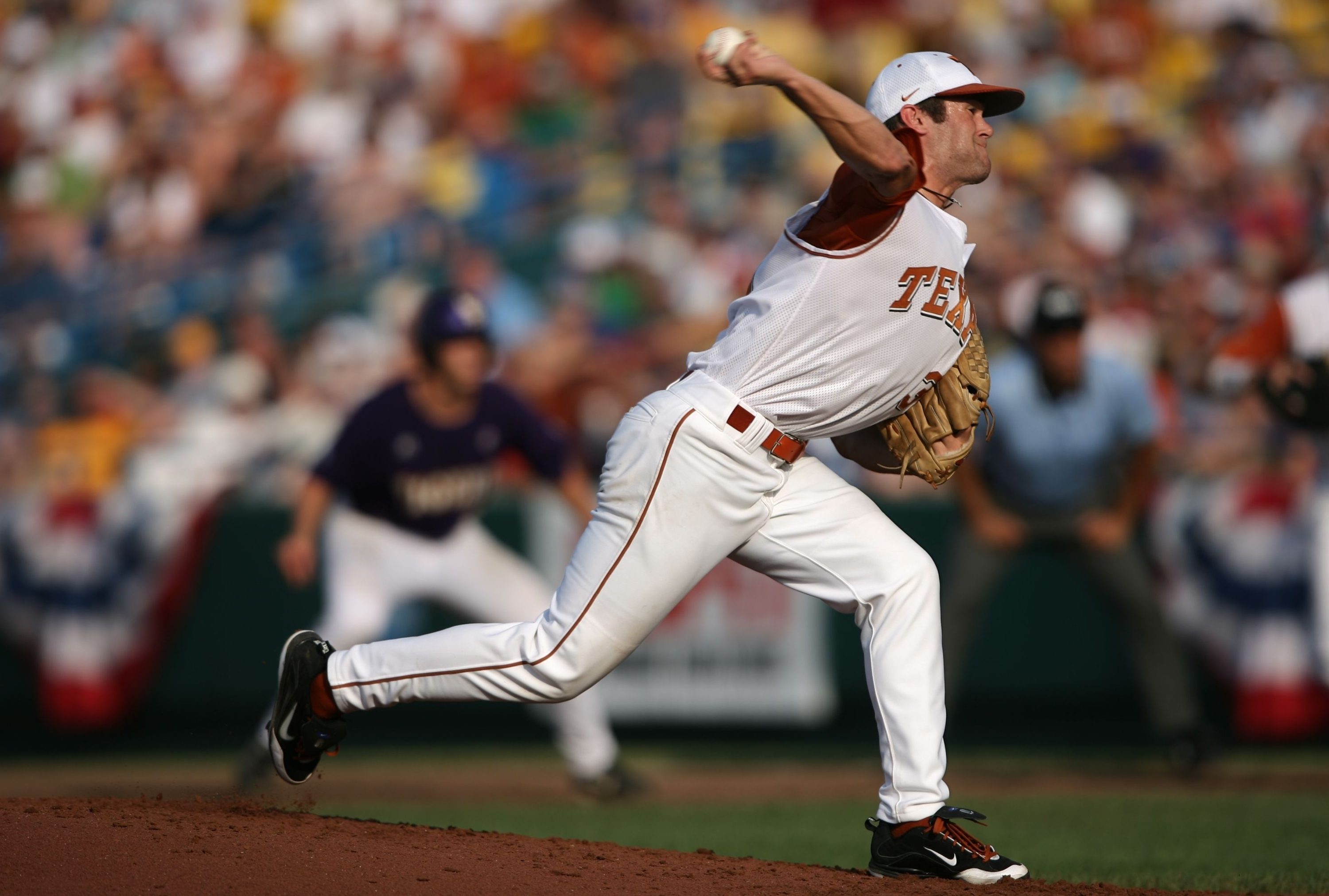 OMAHA, NE - JUNE 22:  Chance Ruffin #31 of the Texas Longhorns pitches with a runner on first base against the Louisiana State University Tigers during Game One of the 2009 NCAA College World Series at Rosenblatt Stadium on June 22, 2009 in Omaha, Nebrask