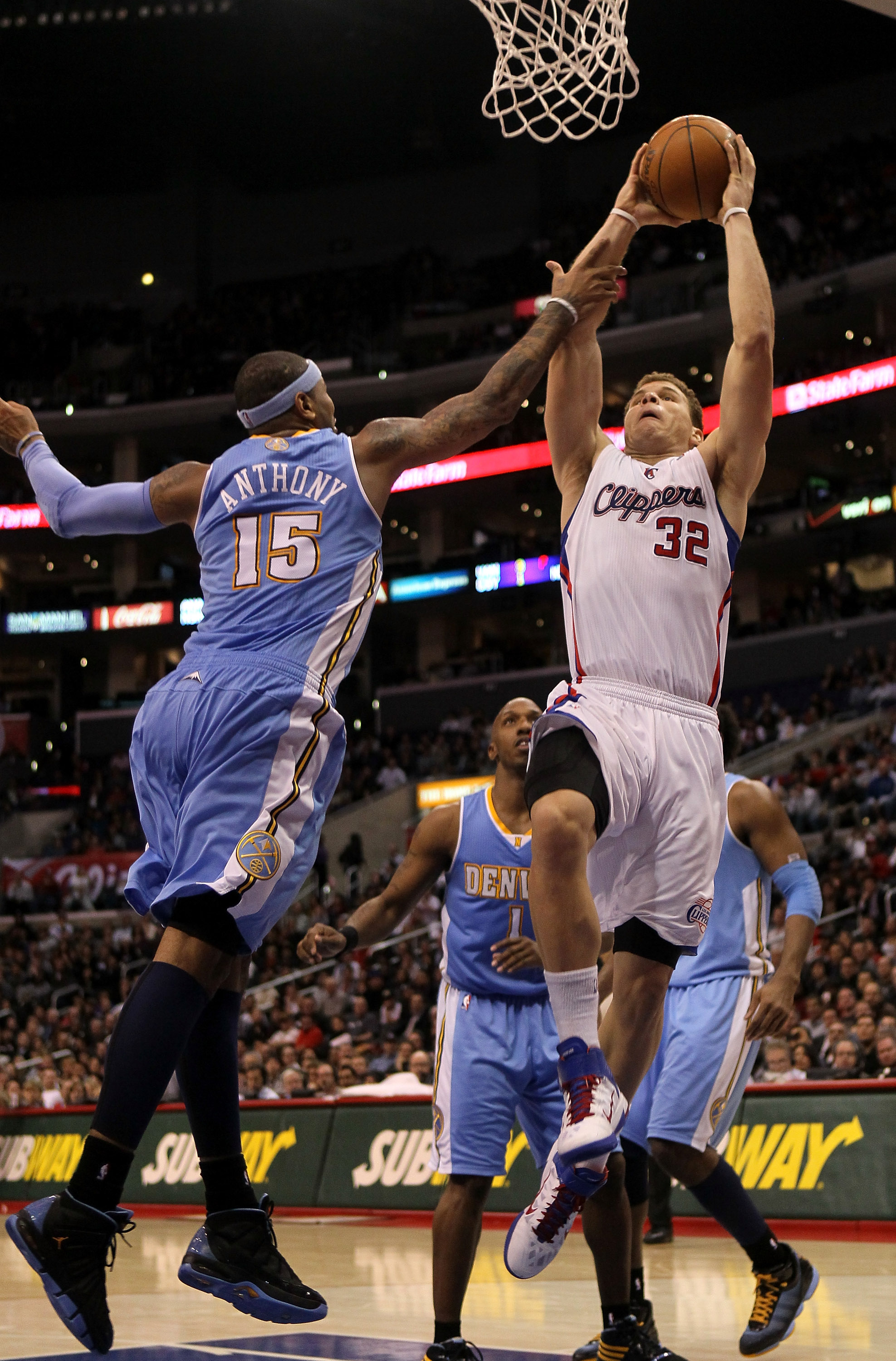LOS ANGELES, CA - JANUARY 5:  Blake Griffin #32 of the Los Angeles Clippers goes up for a shot over Carmelo Anthony #15 of the Denver Nuggets at Staples Center on January 5, 2011  in Los Angeles, California. The Clippers won 106-93.  NOTE TO USER: User ex