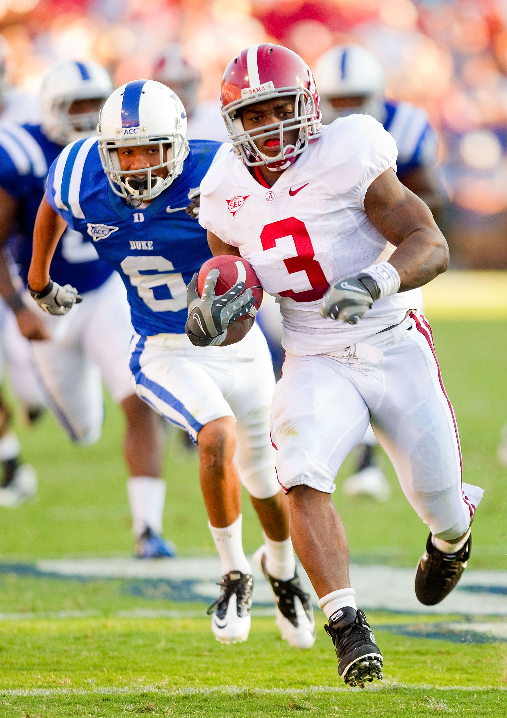 DURHAM, NC - SEPTEMBER 18: Trent Richardson #3 of the Alabama Crimson Tide breaks away from Ross Cockrell #6 of the Duke Blue Devils for a 45-yard touchdown run at Wallace Wade Stadium on September 18, 2010 in Durham, North Carolina.  The Crimson Tide def