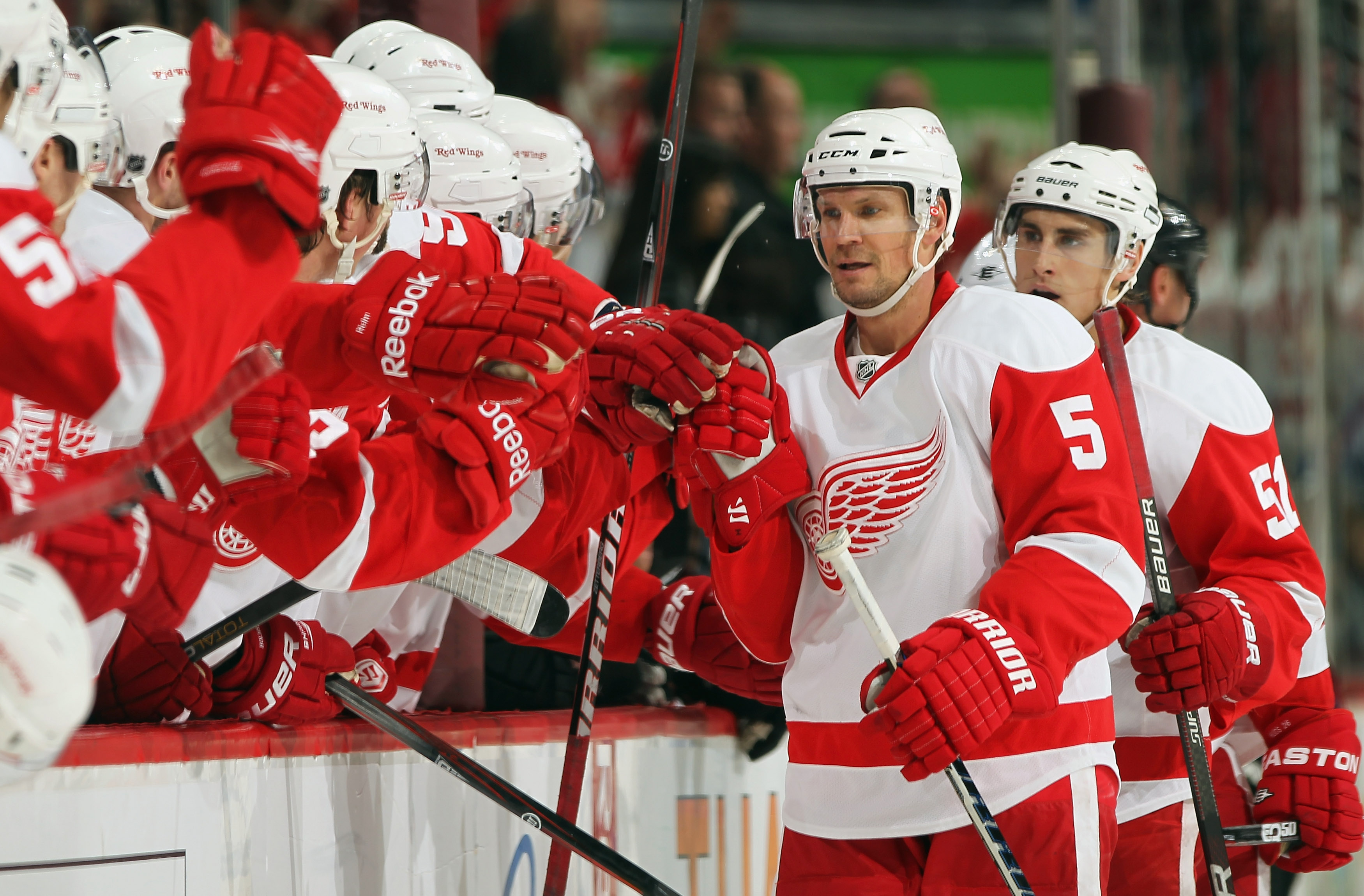 DENVER - DECEMBER 27:  Nicklas Lidstrom #5 of the Detroit Red Wings celebrates his third period goal with his bench against the Colorado Avalanche looks on at the Pepsi Center on December 27, 2010 in Denver, Colorado. The Red Wings defeated the Avalanche