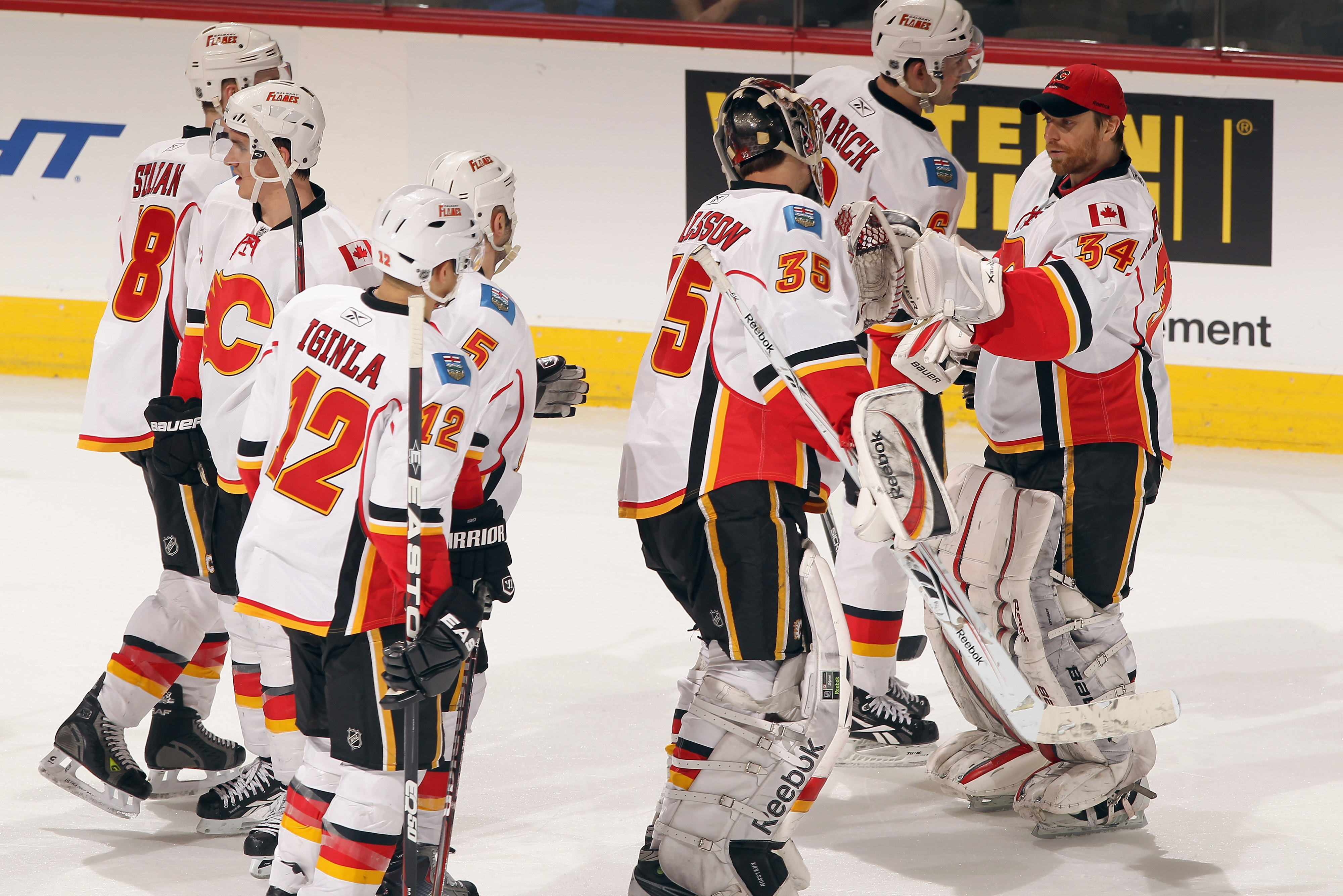 DENVER, CO - FEBRUARY 14:  The Calgary Flames celebrate their victory over the Colorado Avalanche defends at the Pepsi Center on February 14, 2011 in Denver, Colorado. The Flames defeated the Avalanche 9-1.  (Photo by Doug Pensinger/Getty Images)