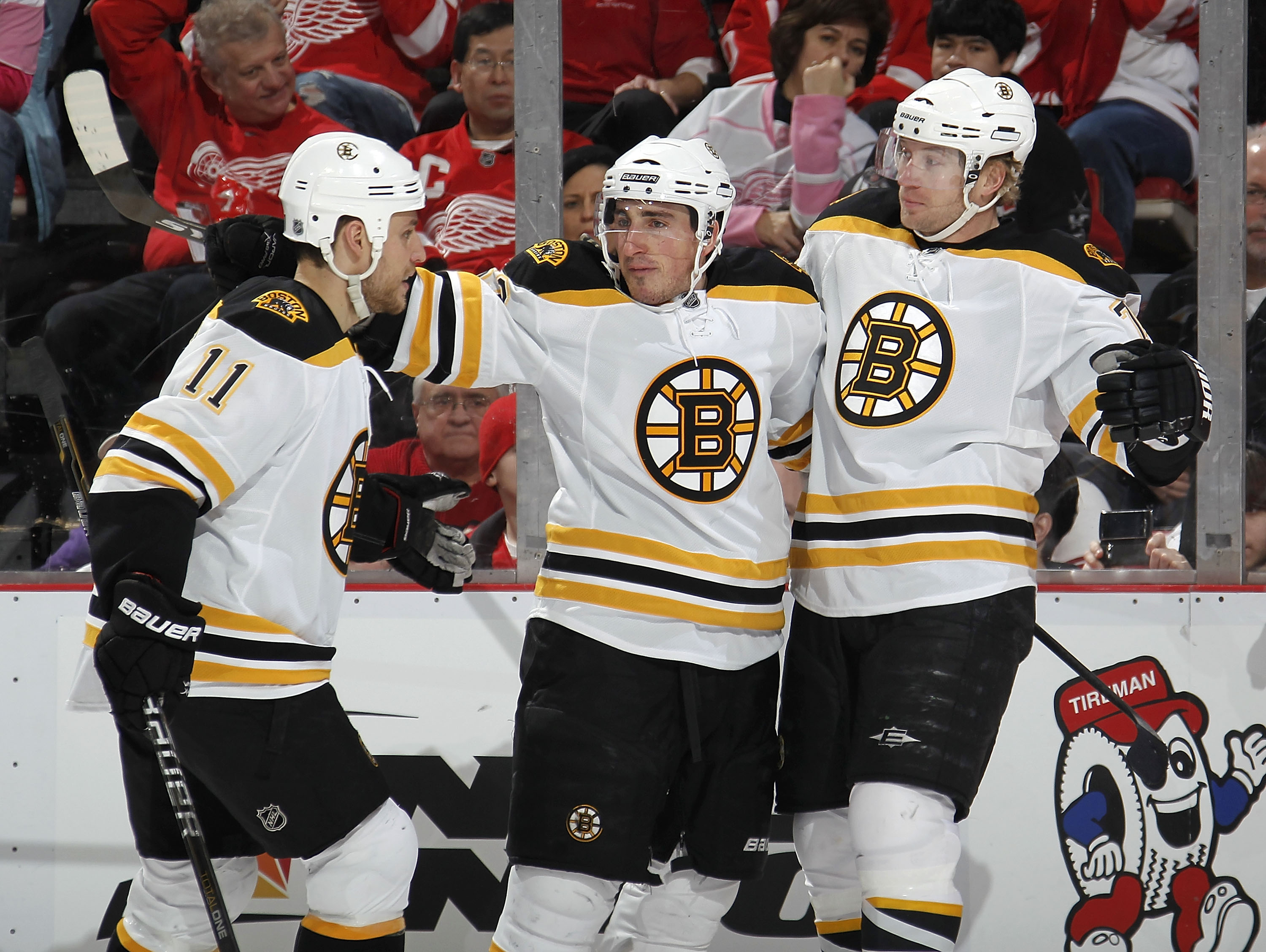 DETROIT, MI - FEBRUARY 13:  Brad Marchand #63 of the Boston Bruins celebrates a first period goal with Michael Ryder #73 and Gregory Campbell #11 while playing the Detroit Red Wings on February 13, 2011 at Joe Lewis Arena in Detroit, Michigan.  (Photo by