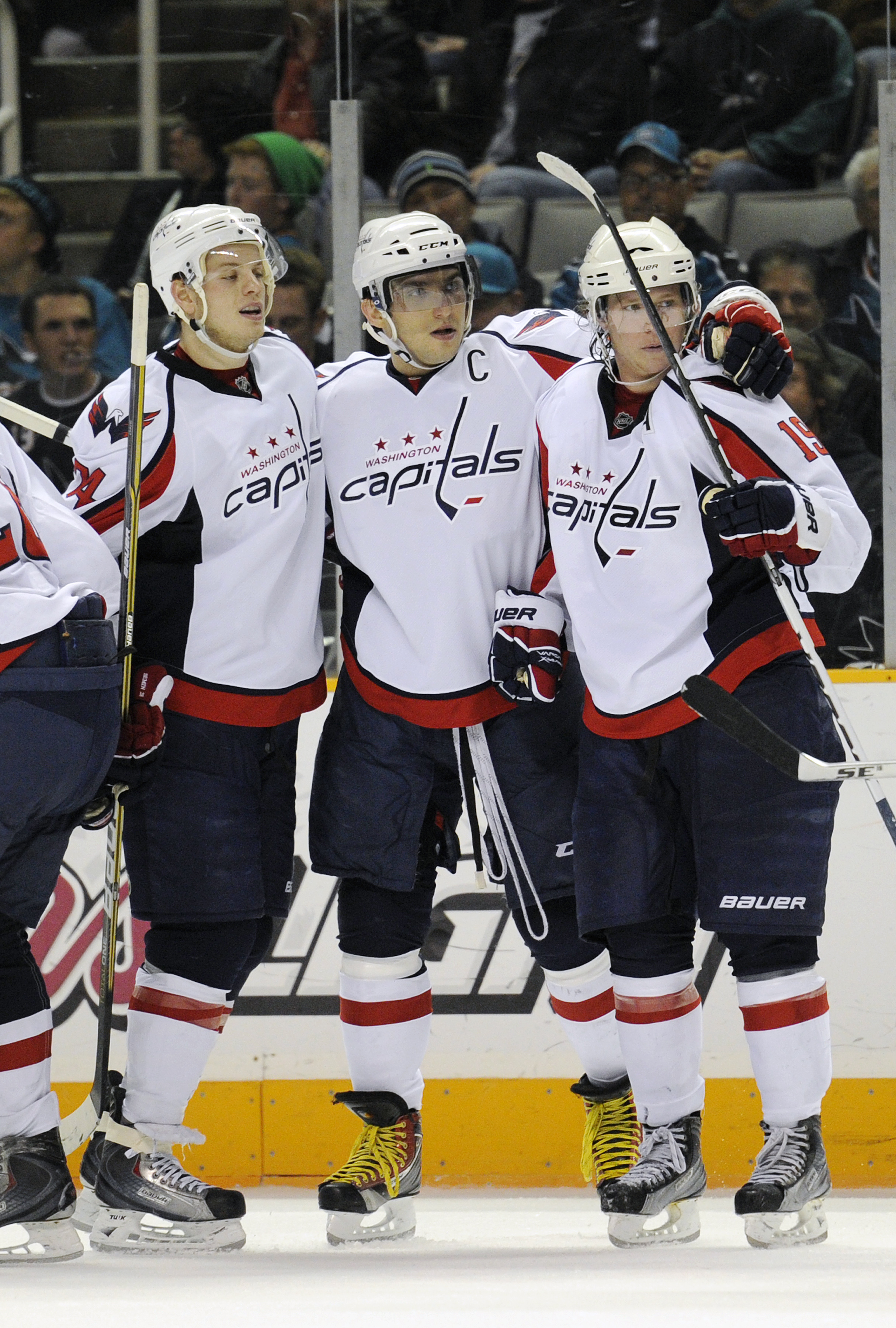 SAN JOSE, CA - FEBRUARY 17: Nicklas Backstrom #19 of the Washington Capitals celebrates with teammates John Carlson #74 and Alex Ovechkin #8 after scoring a goal against the San Jose Sharks in the third period during an NHL hockey game at the HP Pavilion