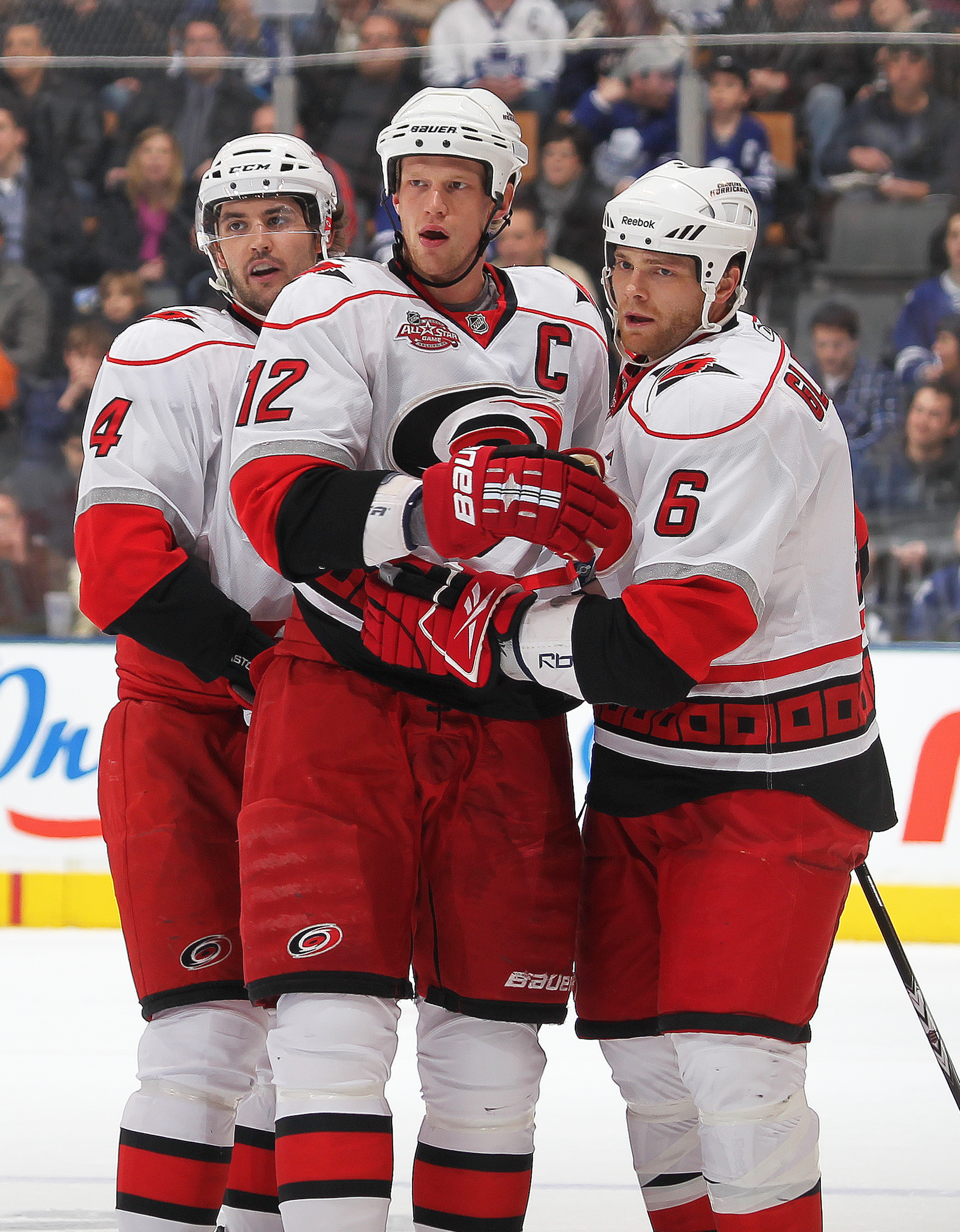 TORONTO,ON - DECEMBER 28:  Eric Staal #12 of the Carolina Hurricanes receives congratulations from his teammates after scoring his second goal in a game against the Toronto Maple Leafs on December 28, 2010 at the Air Canada Centre in Toronto, Ontario. (Ph