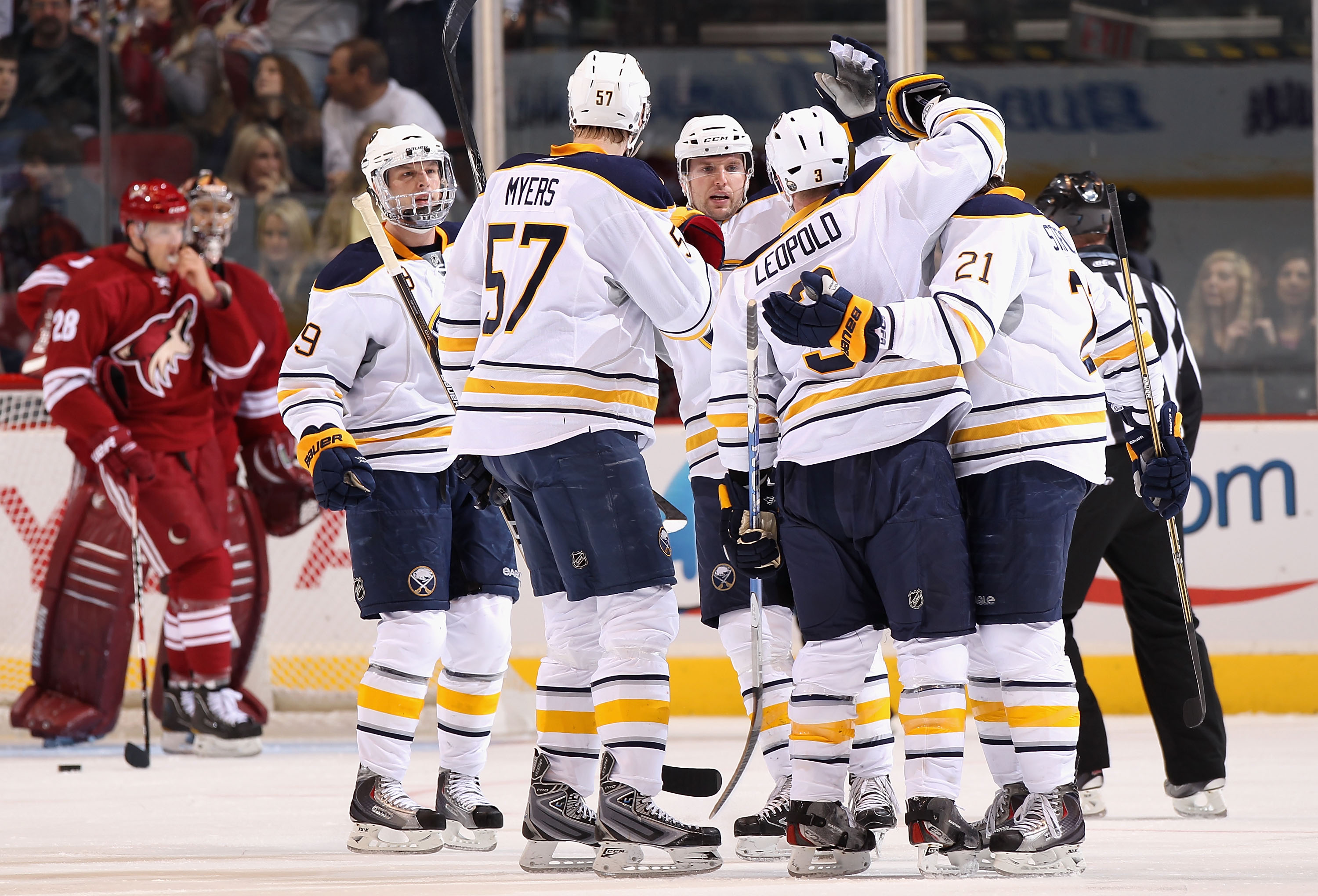 GLENDALE, AZ - JANUARY 08:  Jordan Leopold #3 of the Buffalo Sabres is congratulated by teammates after scoring a second period goal against goaltender Jason LaBarbera #1 of the Phoenix Coyotes during the NHL game at Jobing.com Arena on January 8, 2011 in