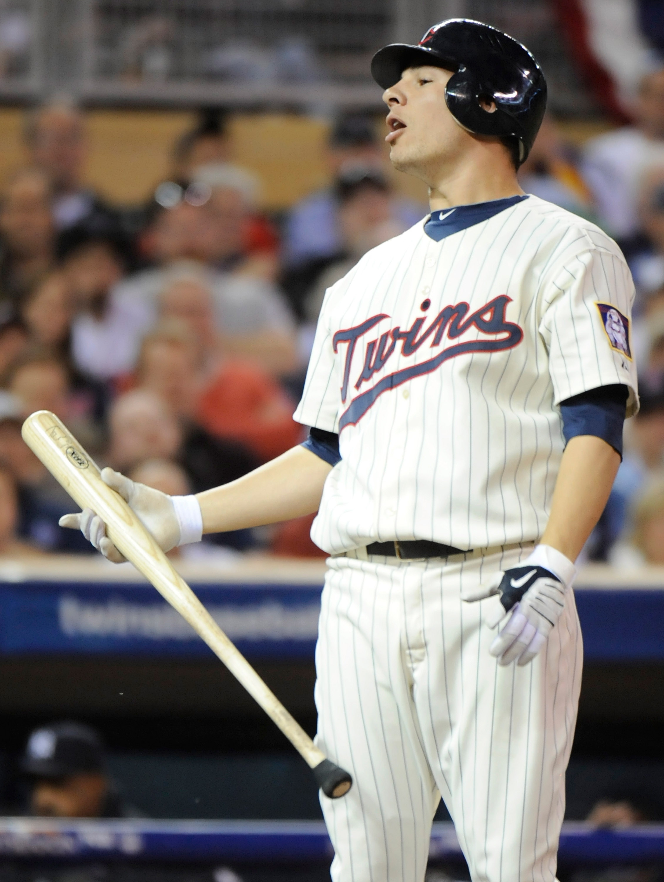 MINNEAPOLIS, MN - OCTOBER 7: Danny Valencia #19 of the Minnesota Twins reacts to a called third strike in the seventh inning during game two of the ALDS game against the New York Yankees on October 7, 2010 at Target Field in Minneapolis, Minnesota. (Photo
