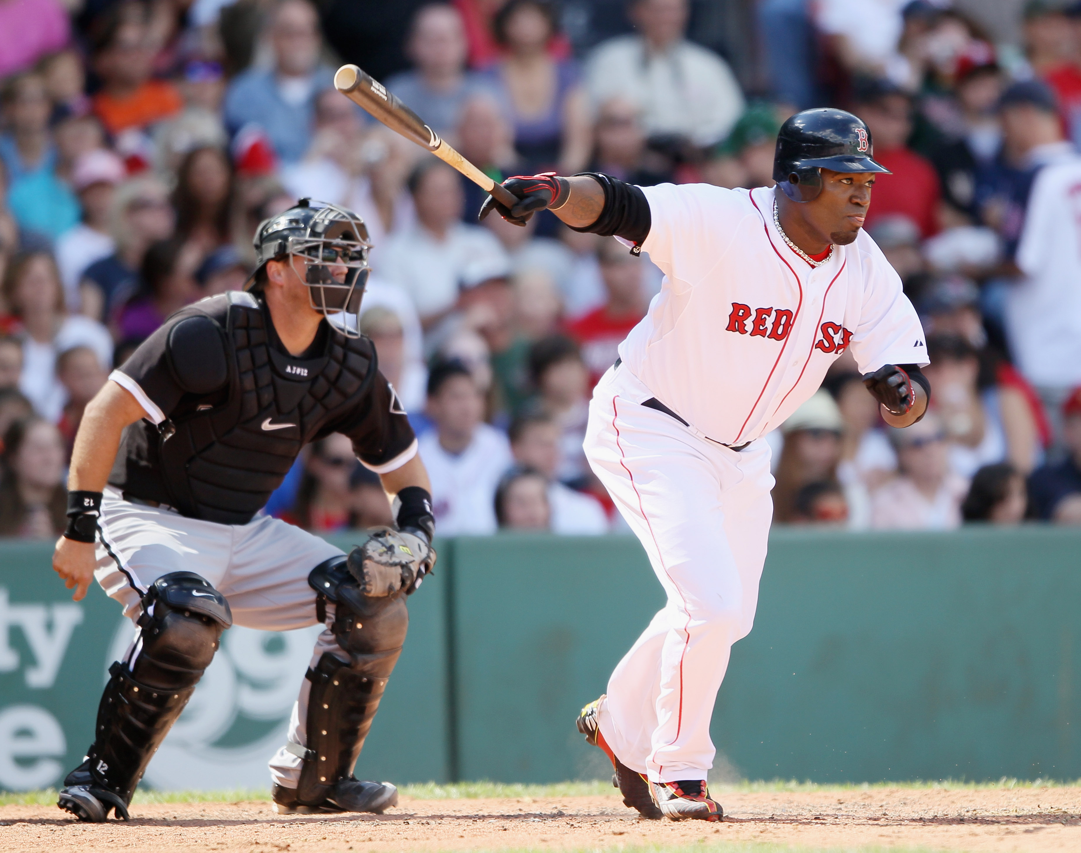 BOSTON - SEPTEMBER 05:  David Ortiz #34 of the Boston Red Sox hits a 2RBI double in the third inning as A.J. Pierzynski #12 the Chicago White Sox defends on September 5, 2010 at Fenway Park in Boston, Massachusetts.  (Photo by Elsa/Getty Images)